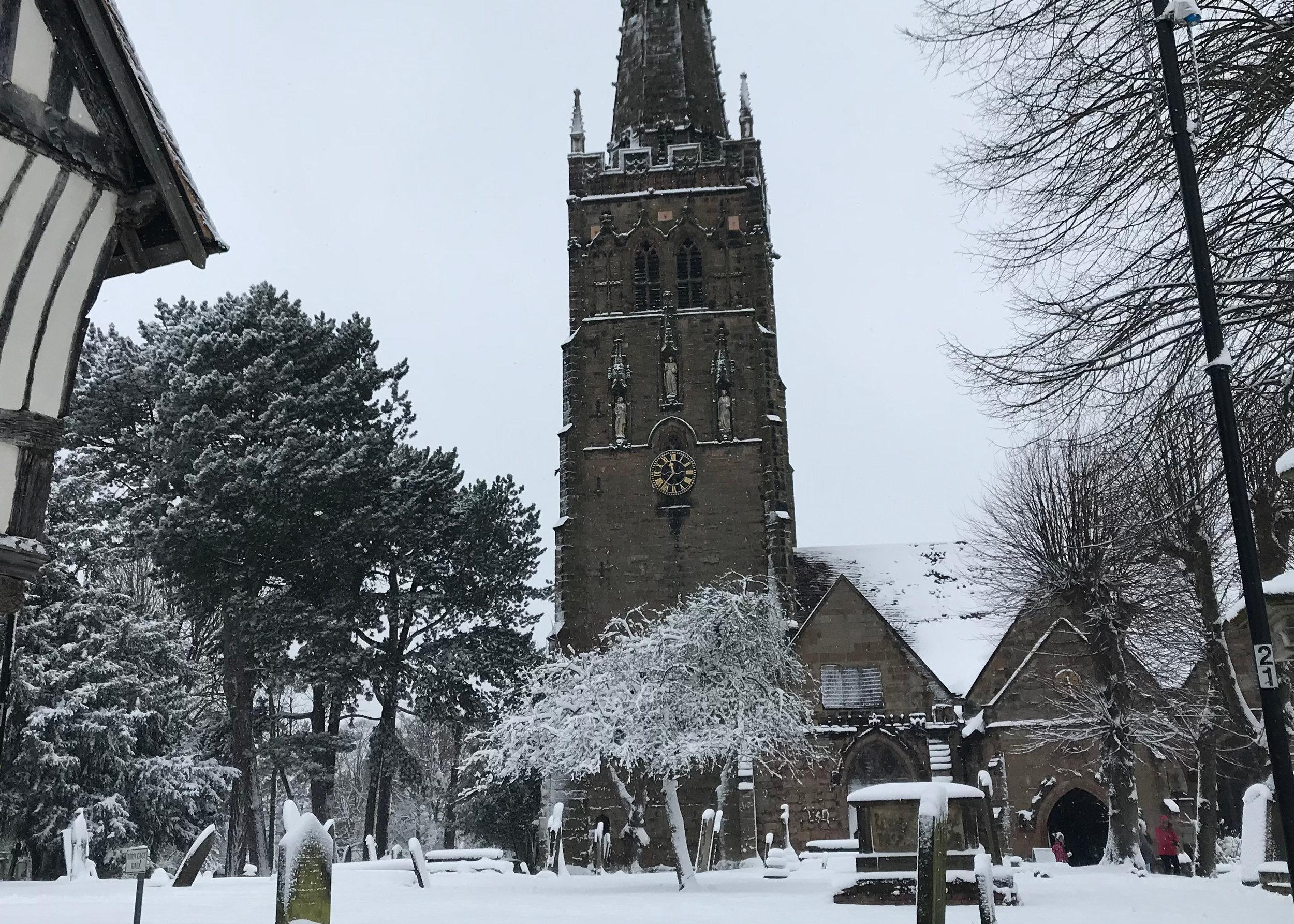 A snowy scene across to the Church