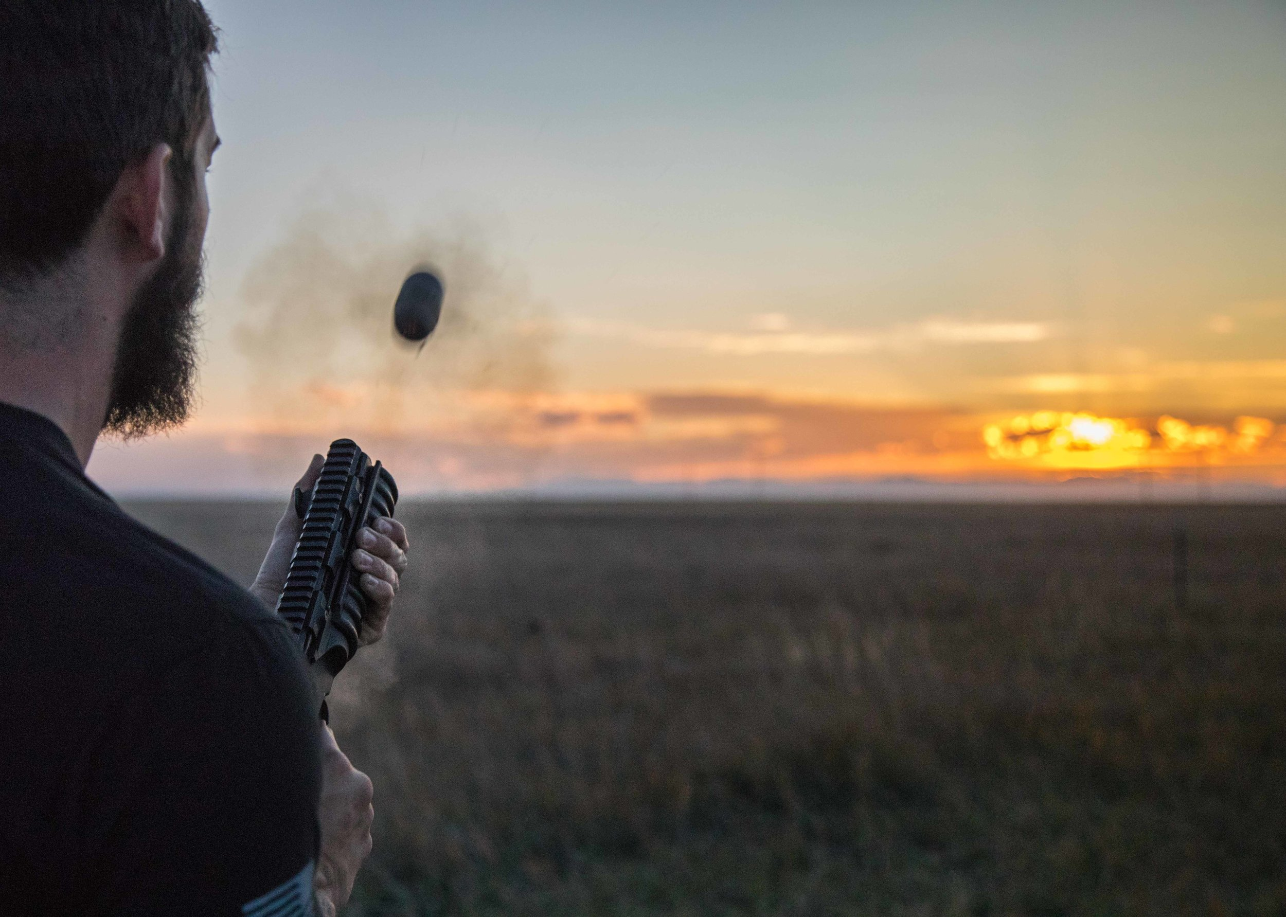 For this shot I used a very fast shutter speed of 1/4000. You will notice this captures the 40mm grenade coming out of the gun (yeah I know, wtf am I do doing shooting this sort of photo? It was for a tactical gear company.) Because the sun was setting there wasn't a whole lot of light to play with so I had to reduce the aperture to f/4 to let in a lot of light as well as bump up the ISO. The result is a very shallow depth of field and a lot of visible noise (that's the grainy stuff) in the photo.  Canon 5D Mark IV, 24-105mm | f/4, 1/4000, ISO 3200