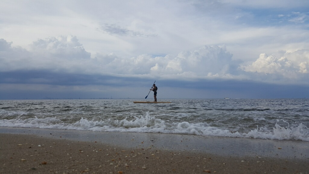 The other Oscar in my paddling life - a volunteer at Hoboken Cove - tempting the great white sharks of Sandy Hook! (Photo courtesy of Kirsten Brink)