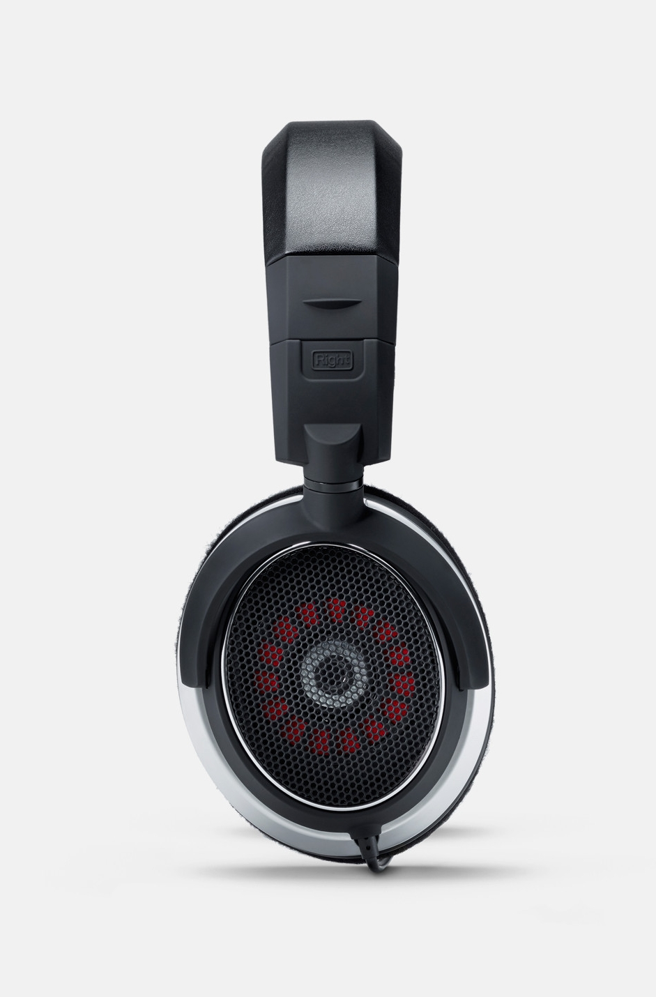 Status Audio OB-1 showing its exposed dynamic driver diaphram. The open back design helps this headphone deliver a spacious sound with a wide and detailed soundstage.