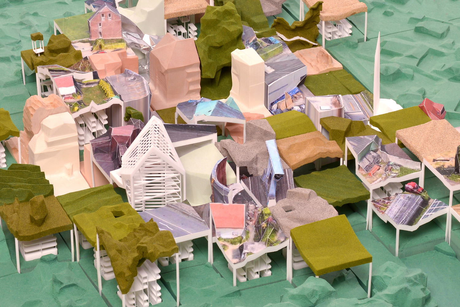 Low Res City – The Phygital Warehouse, Y5. Tutors: Prof. Laura Allen and Prof. Mark Smout . A large scale model of 'Low Res City' served as testbed to celebrate and evaluate existing and novel ways of fabrication. Using photogrammetry on screenshots allowed me to obtain low-resolution pointclouds of the whole city. Pinpointing where to 'grab' data, the intersections of a coordinate grid overlaying the city perimeter limited my agency as curator. Bit by bit a compressed image of Hamburg got physicalised, using newly developed techniques – Augmented Carving and Papercasting –, paired with established digital fabrication technologies, such as robotic milling and 3D-printing. Challenged by the recomposition of mined and and physicalised specimens, Low Res City forms a provocation towards the image of the city: grabbed from the sky, can a shed in the backgarden, a street corner, a field of crops become truer representatives of the city fabric and its phygital moments?
