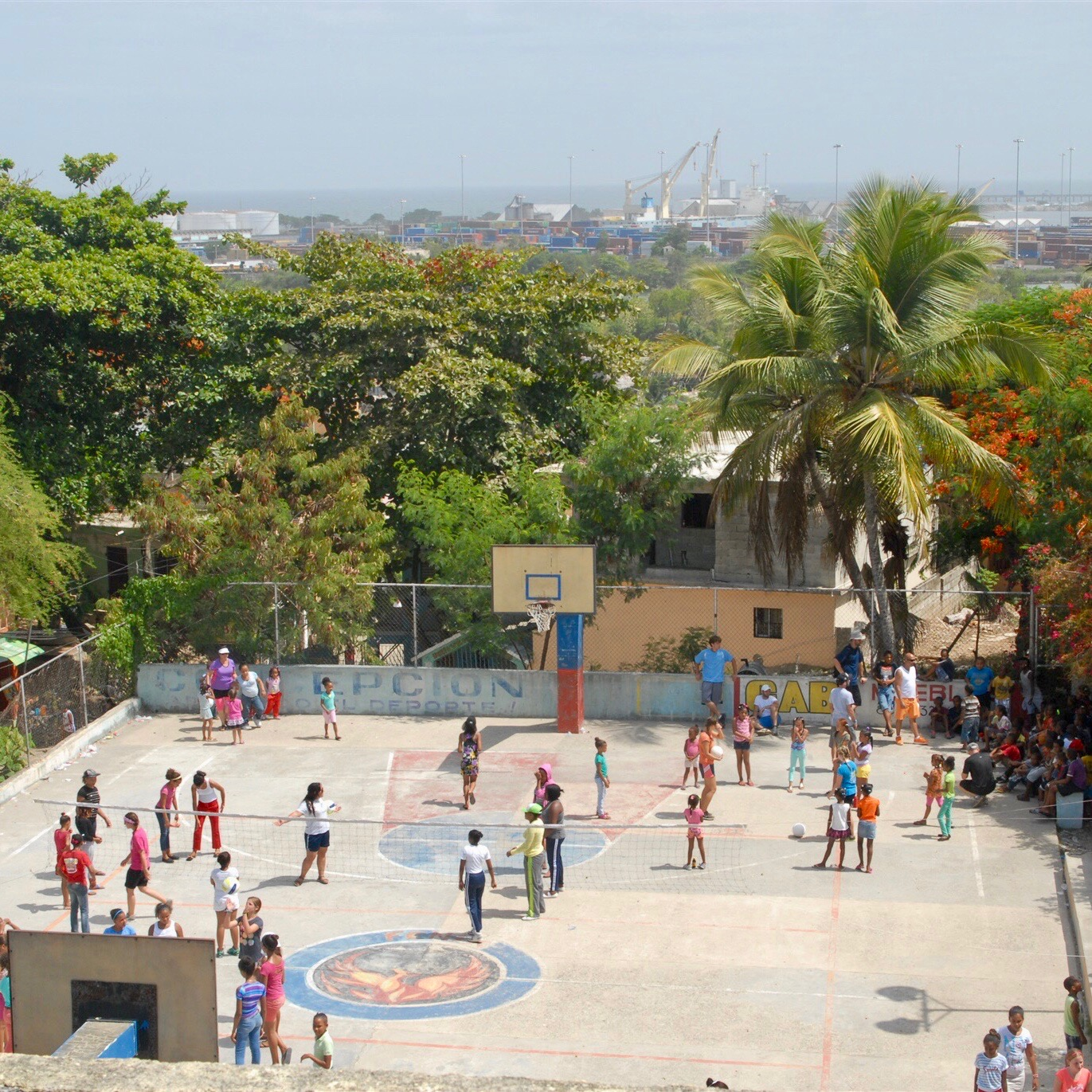 Sports ministry is a key component of work in the port city of Haina.  This court is across the street from El Refugio, our partner church.
