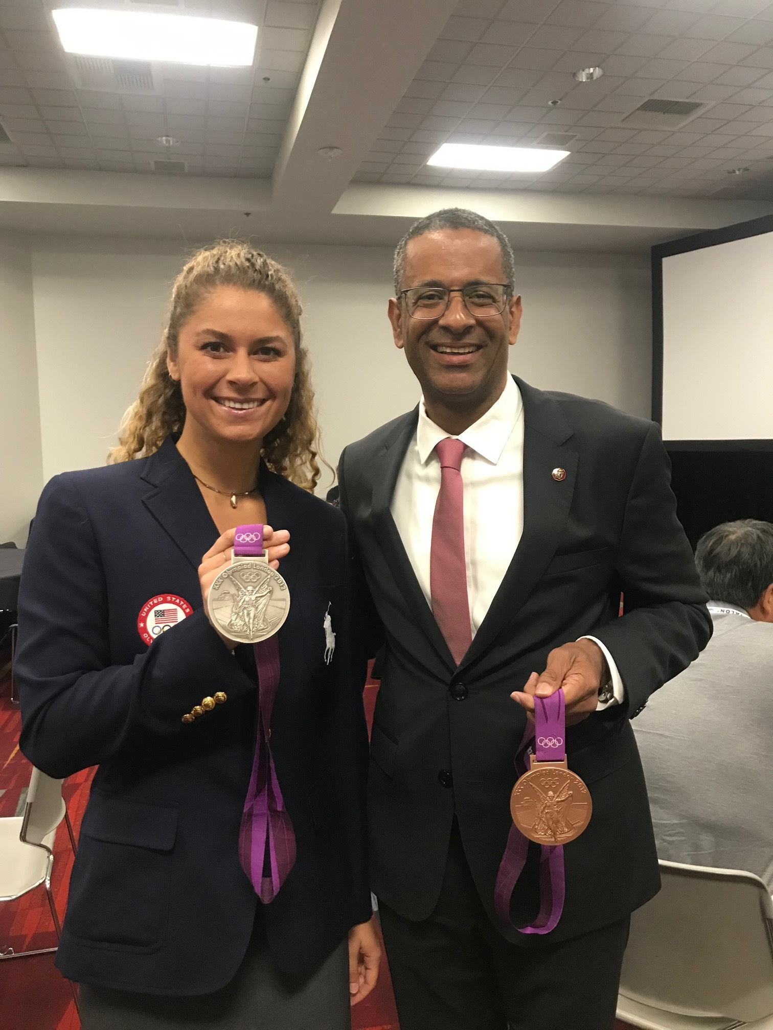 3-time USA swimming Olympian Elizabeth Beisel with AIA IR President Thierry Paret, FAIA at the IR Design Awards during A'19.    Beisel's heartfelt words on striving for excellence resonated with the crowd and furthered the collaboration between AIA IR and the Dow- IOC carbon partnership towards a sustainable built future.