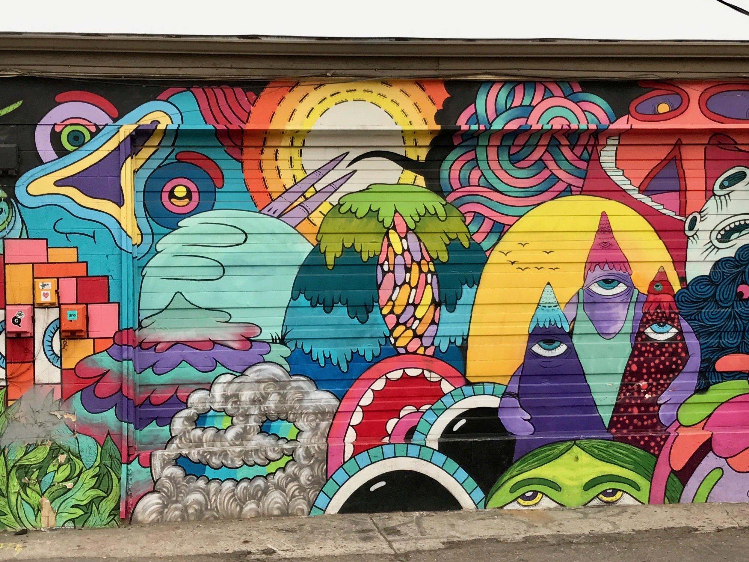 A mural by  RUMTUM  in Denver's RiNo neighborhood.