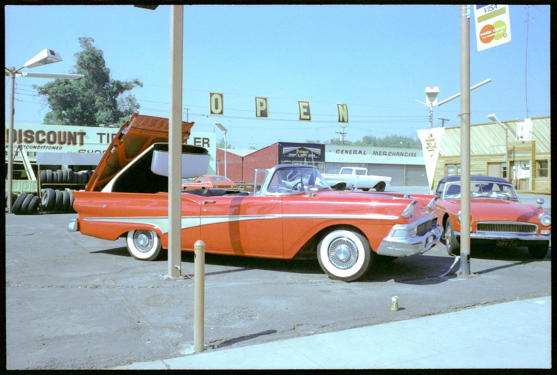Lewis deSoto, E Street car lot, San Bernardino, California, 1979, Archival pigment print, 13 x 20 inches, Courtesy of the artist.