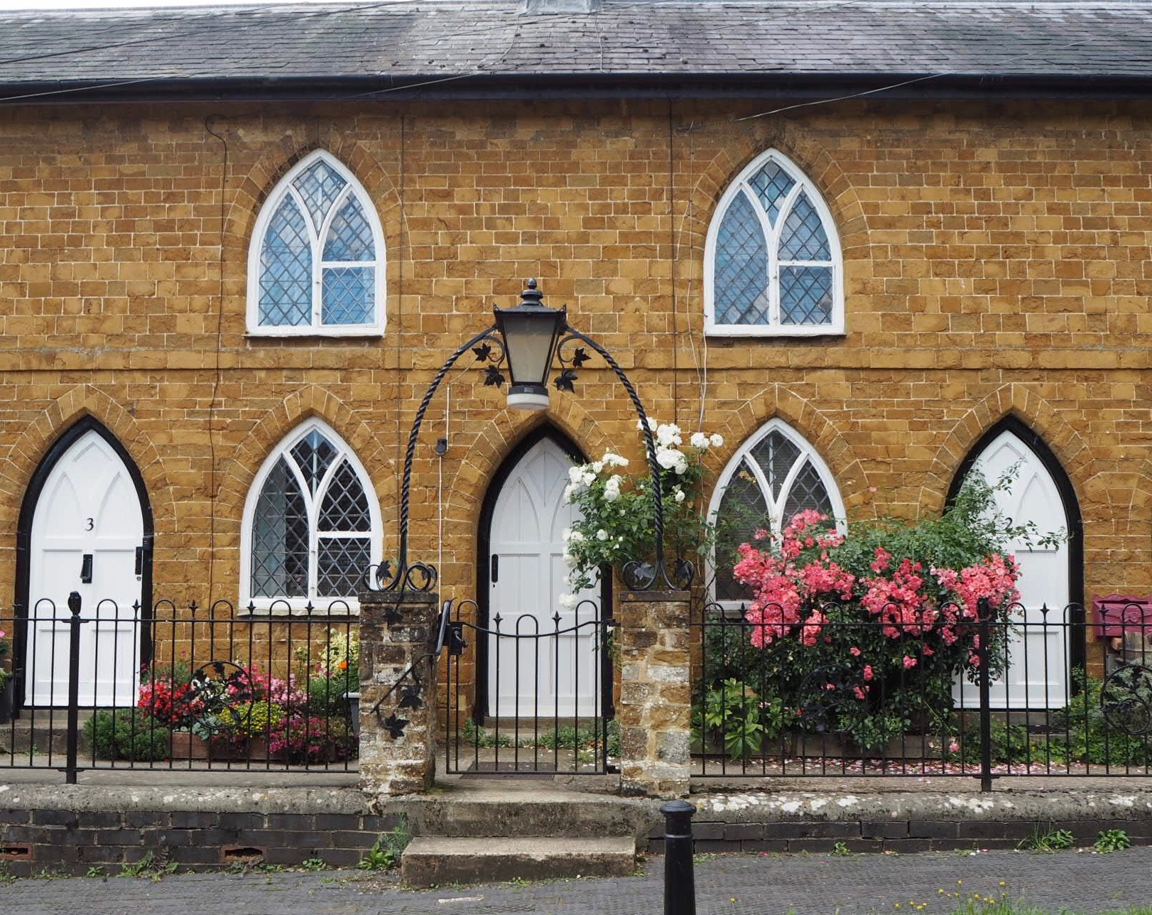 The alms houses behind the church.