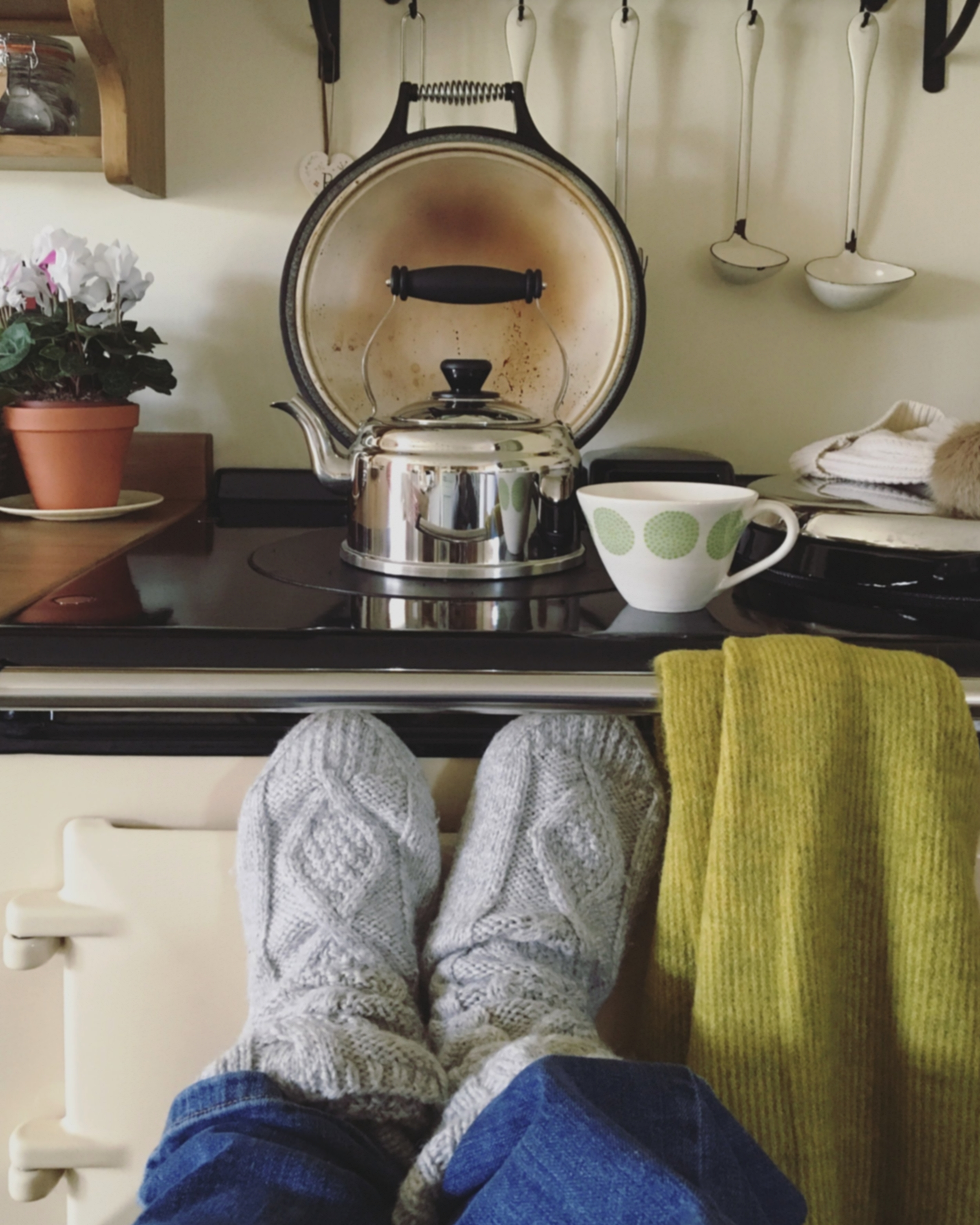 Warming up my feet whilst waiting for the kettle to boil.