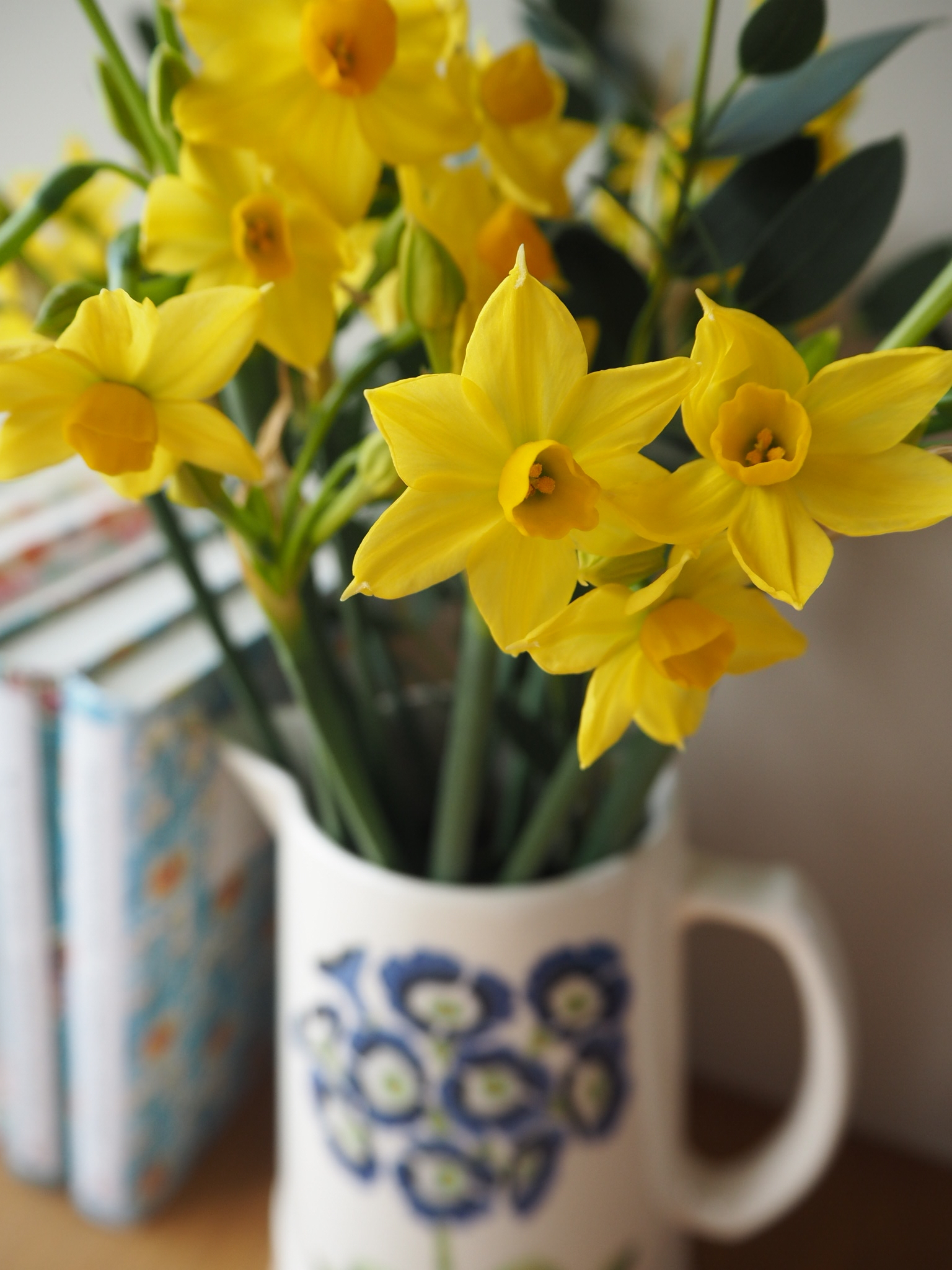 Jugs of spring flowers herald the promise of spring in the home.