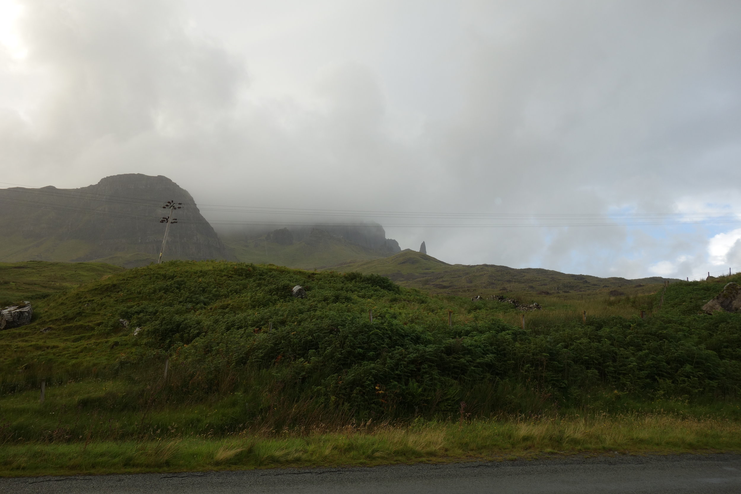 Behold: The Storr. It's the pointy rock thing in the distance. V. impressive, I know. Not picture: me, dying, taking this picture as proof that I made it before I passed out on the highway. Like a CHAMPION.