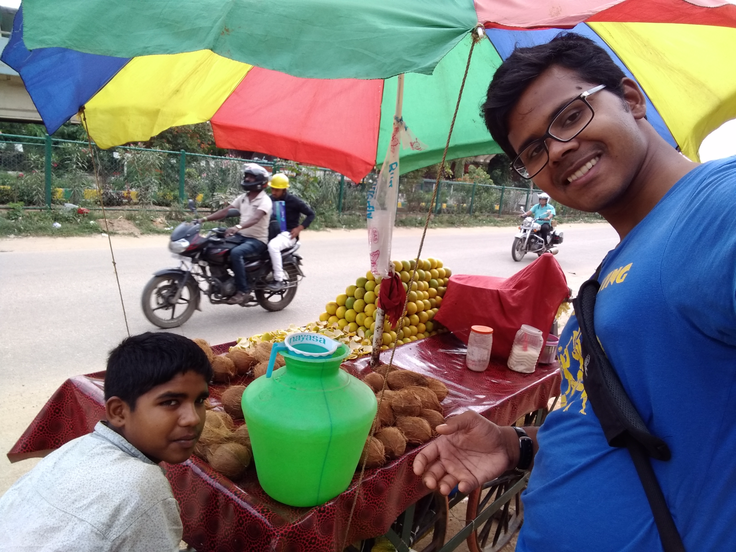 Juice vendor in the streets of Bangaluru   While doing market studies in India, Anurag discussed the advantages of portable and cheap electricity with a young street vendor.