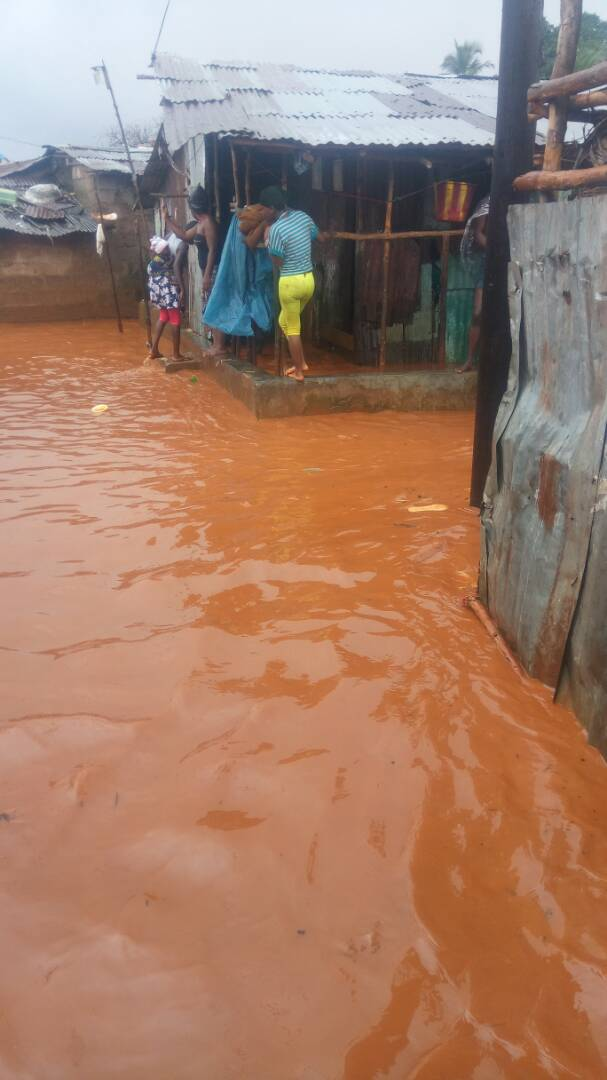 Residents in Kroo Bay, central Freetown, Sierra Leone  barricaded  by flood waters on August 14th, 2017.