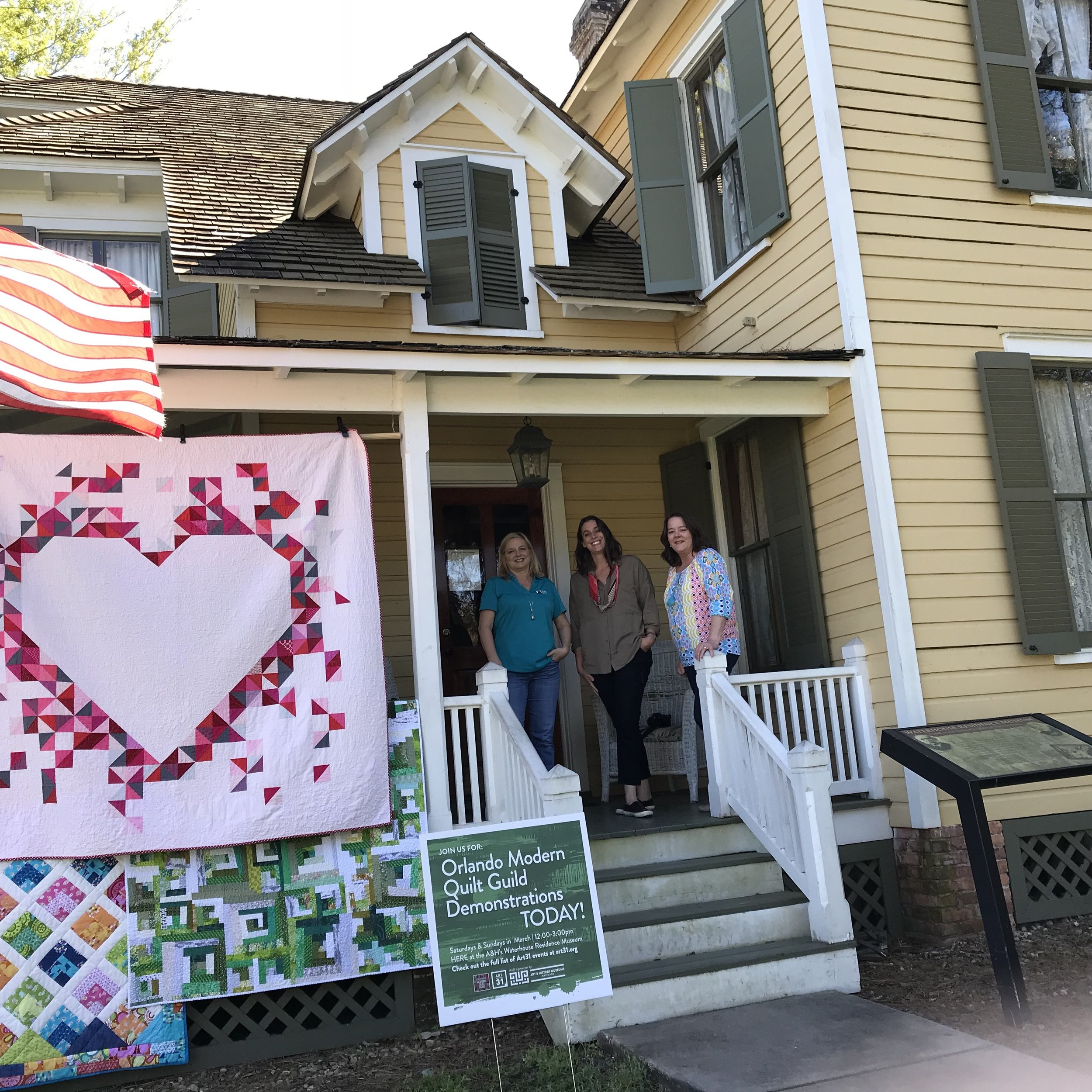 Standing on the porch with  Sarah  and  Michele . Have a Heart quilt on display