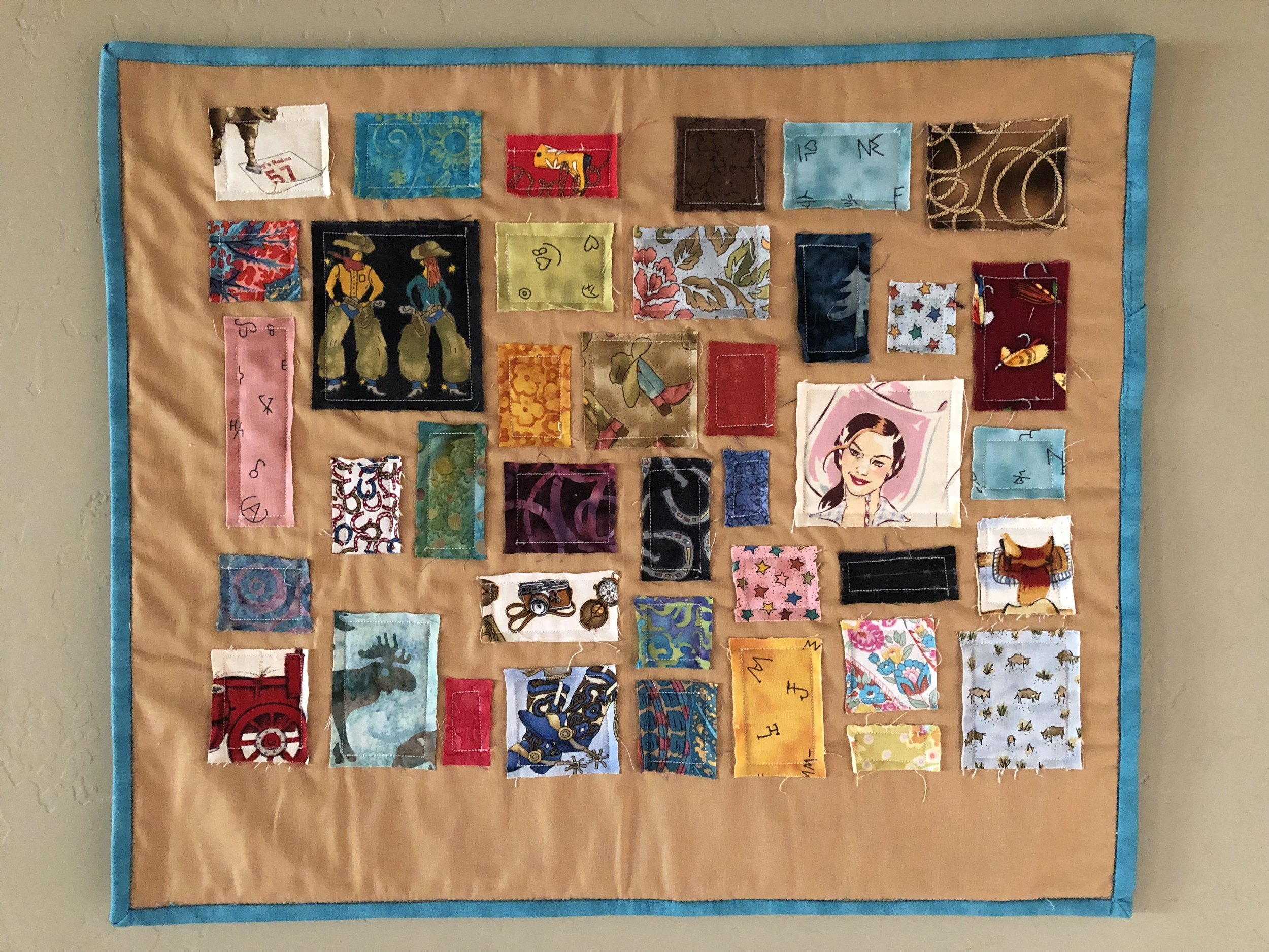 Here's an old Ticker Tape mini quilt I made using mainly scraps from Hey Cowboy.