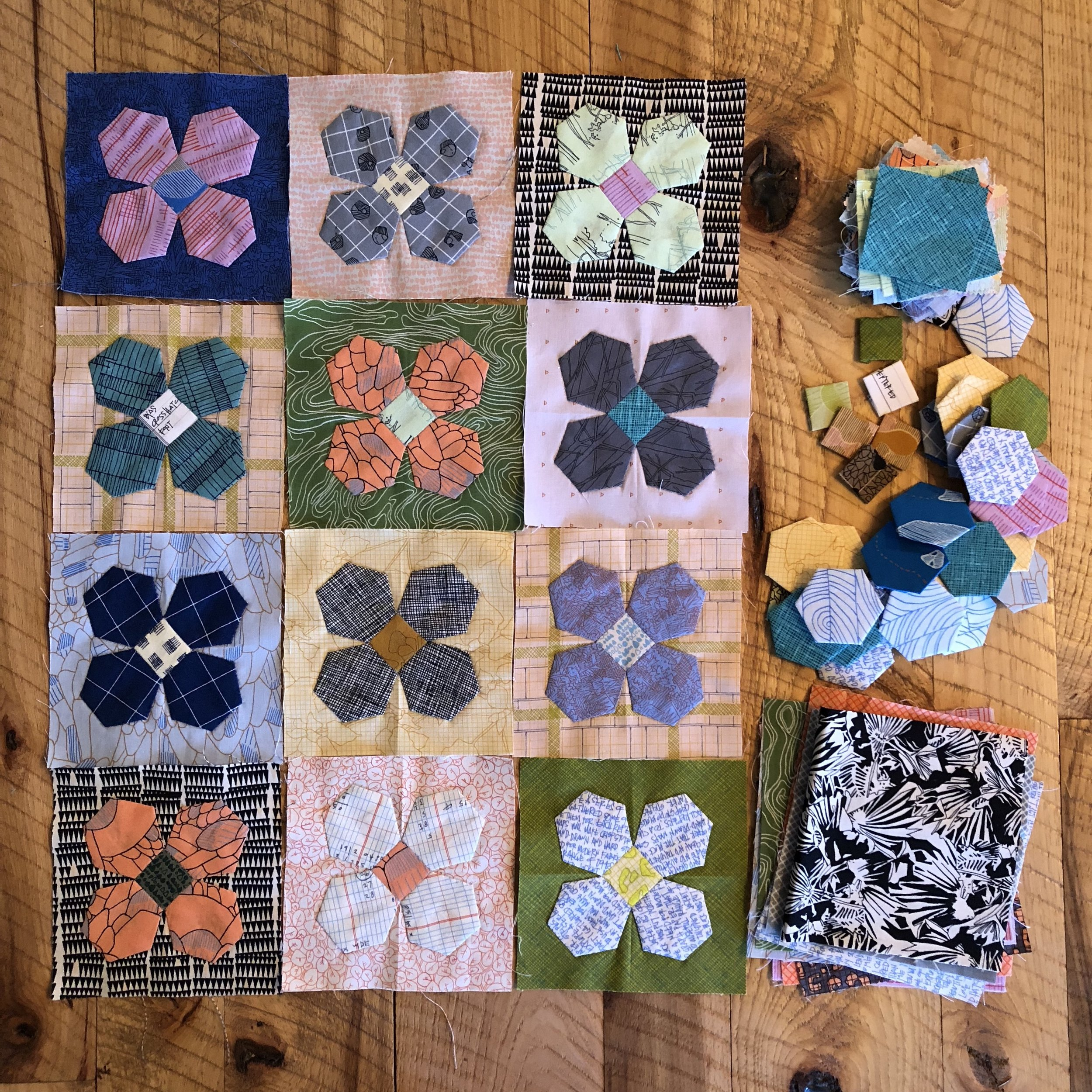 Completed blocks on hand with extra hexies, squares, and fabric