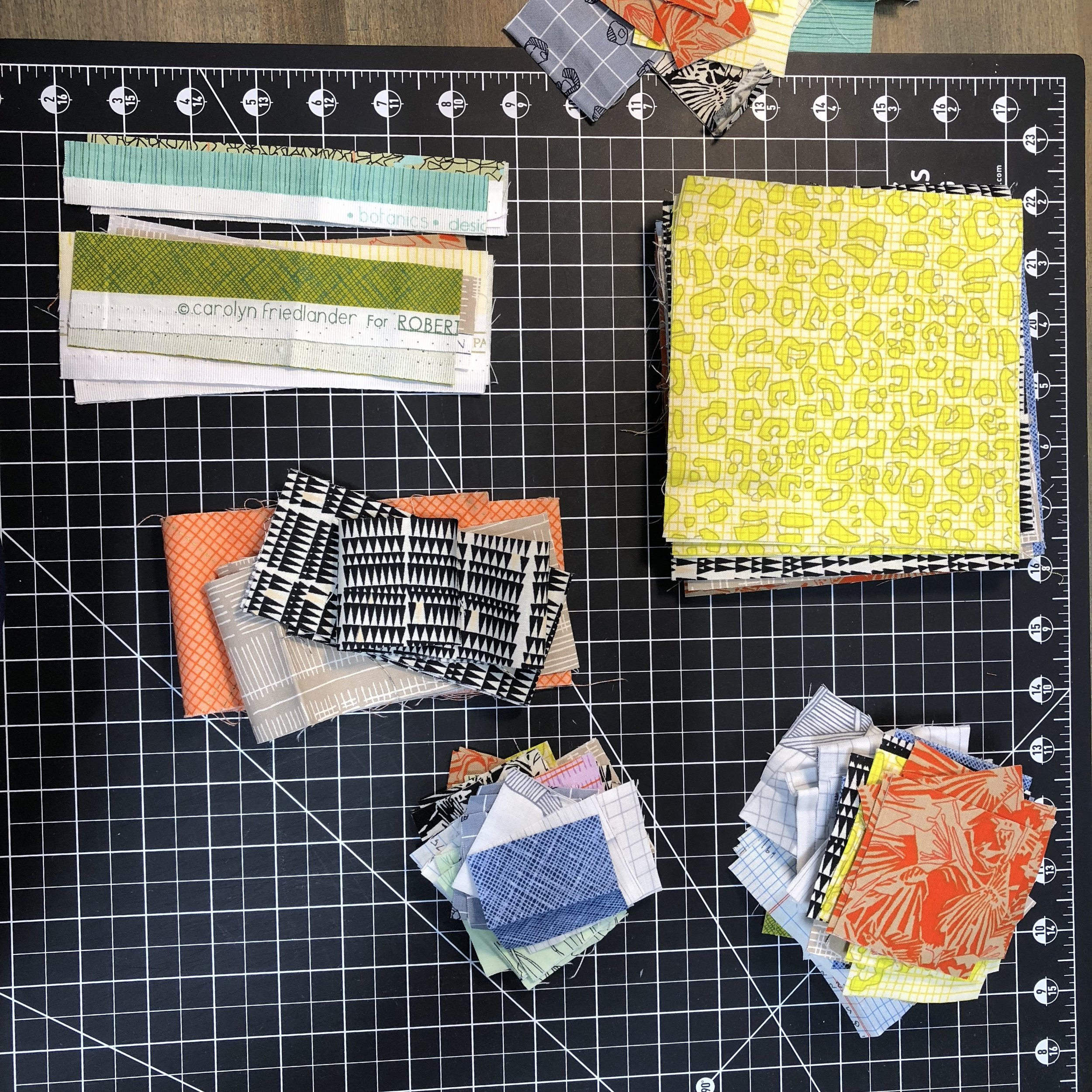 Pretty piles of Carolyn Friedlander fabric cut for various projects.