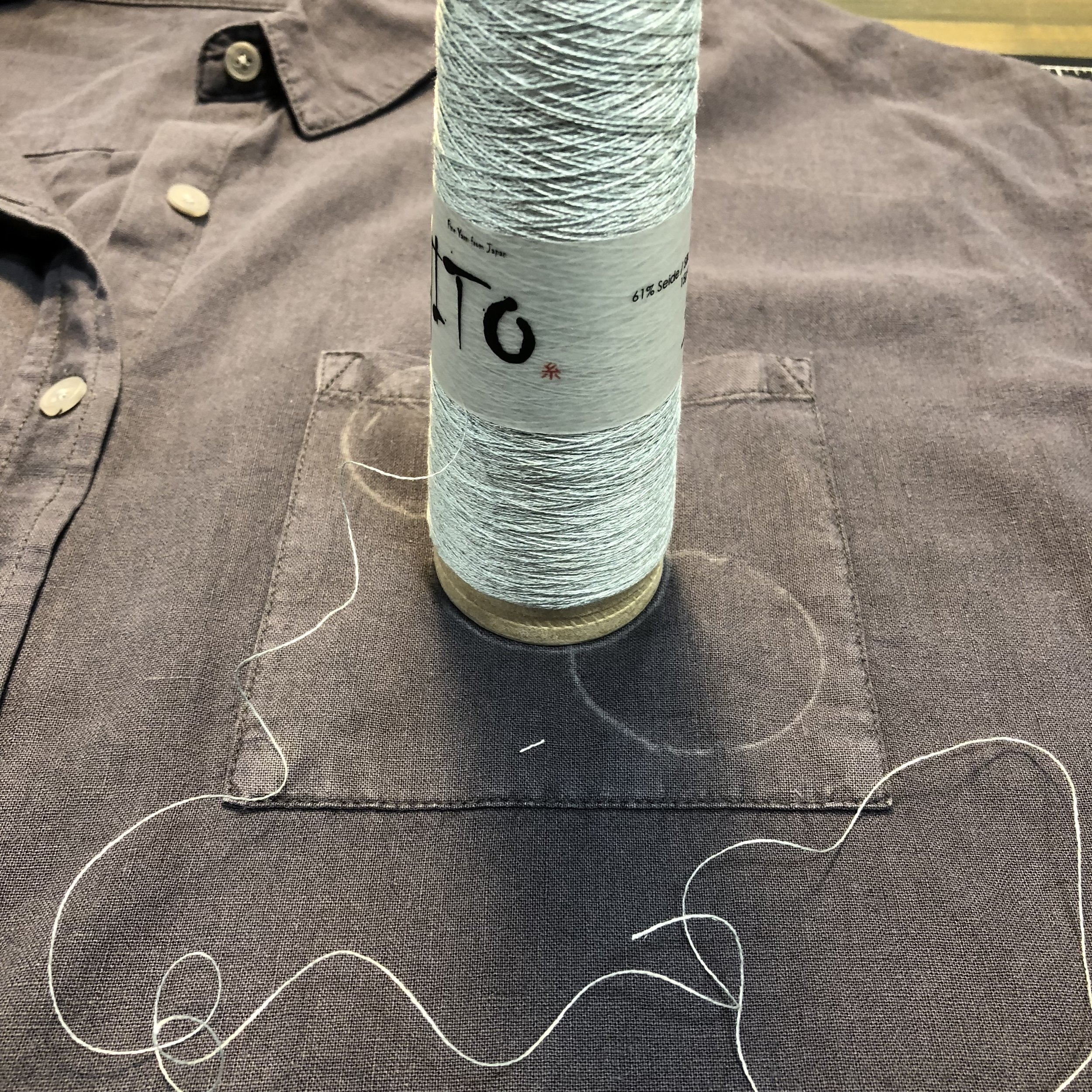 Stitching with silk wrapped stainless steel