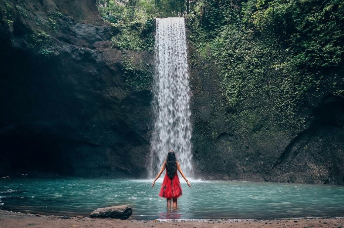 Air terjun waterfall - Tibumana Waterfall is definitely one of the Bali waterfalls that is still kind of a secret. The road into Tibumana is spectacular and one of the best palm tree covered roads we've seen in Bali.