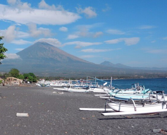 Amed Beach - Amed Beach in Bali is most likely already in your Bali travel itinerary if you're a keen diver. The black sand is what makes Amed Beach so remarkably unique from other beaches. The sand's color is due to the volcanic deposits in the coastal soil.