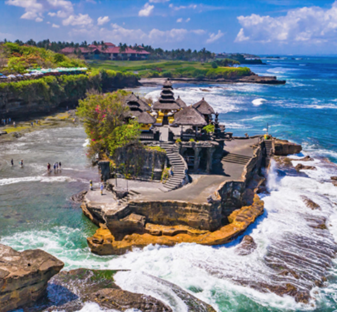 Tanah Lot Temple - Tanah Lot Temple is probably the most popular and photographed temple on the island. Tanah Lot Temple stands for earth (Tanah) and sea (Lot), quite appropriate considering its spectacular setting on top of an impressive rock overlooking the sea.
