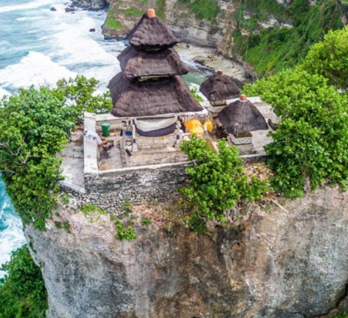 Uluwatu Temple - Uluwatu Temple, or Pura Luhur Uluwatu, one of six key temples believed to be Bali's spiritual pillars, is renowned for its magnificent location.