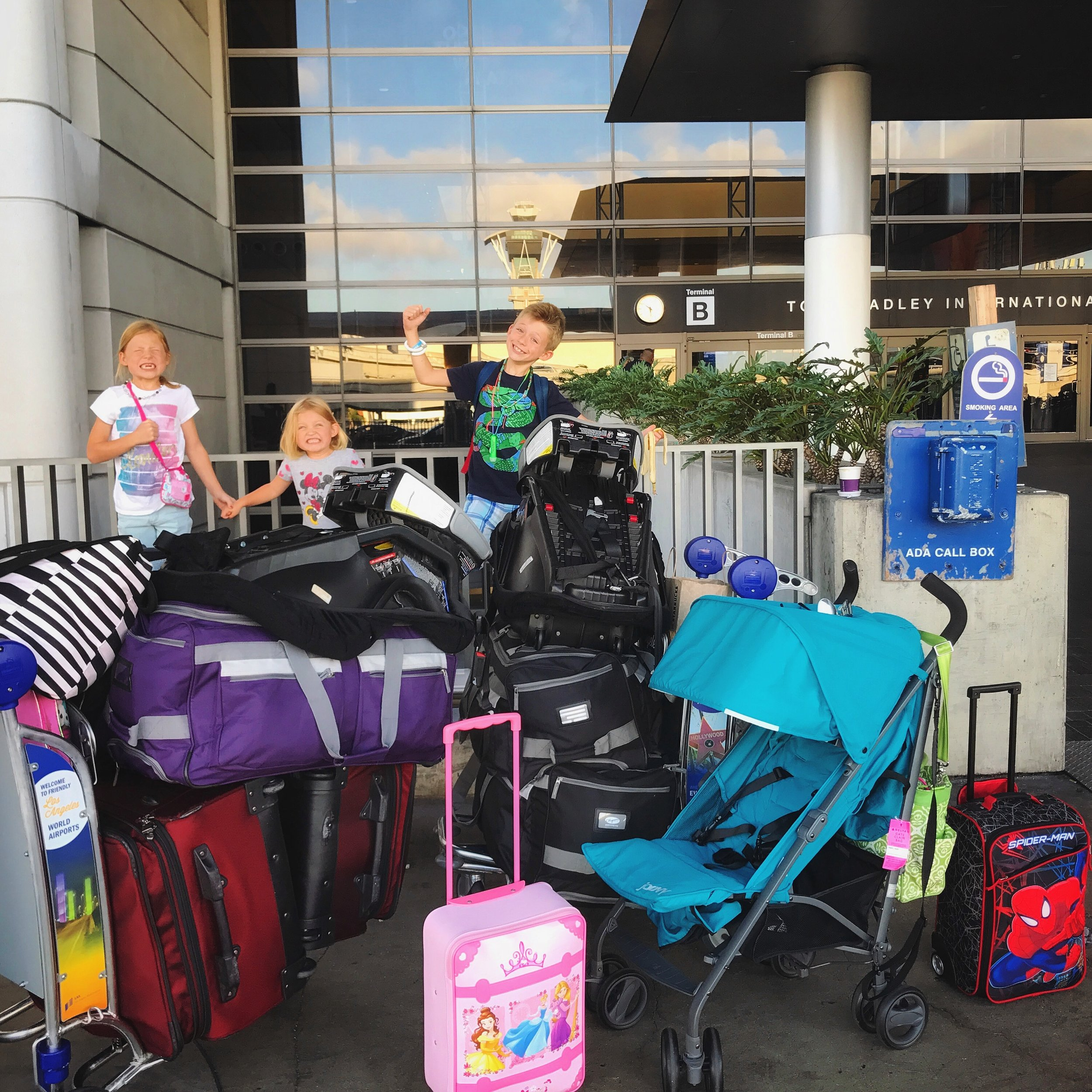 Our minimalist life for a family or six consolidated to this. Everything we would carry with us through two airports, packed into one rental car, and hauled up a combined 16 flights of stairs.