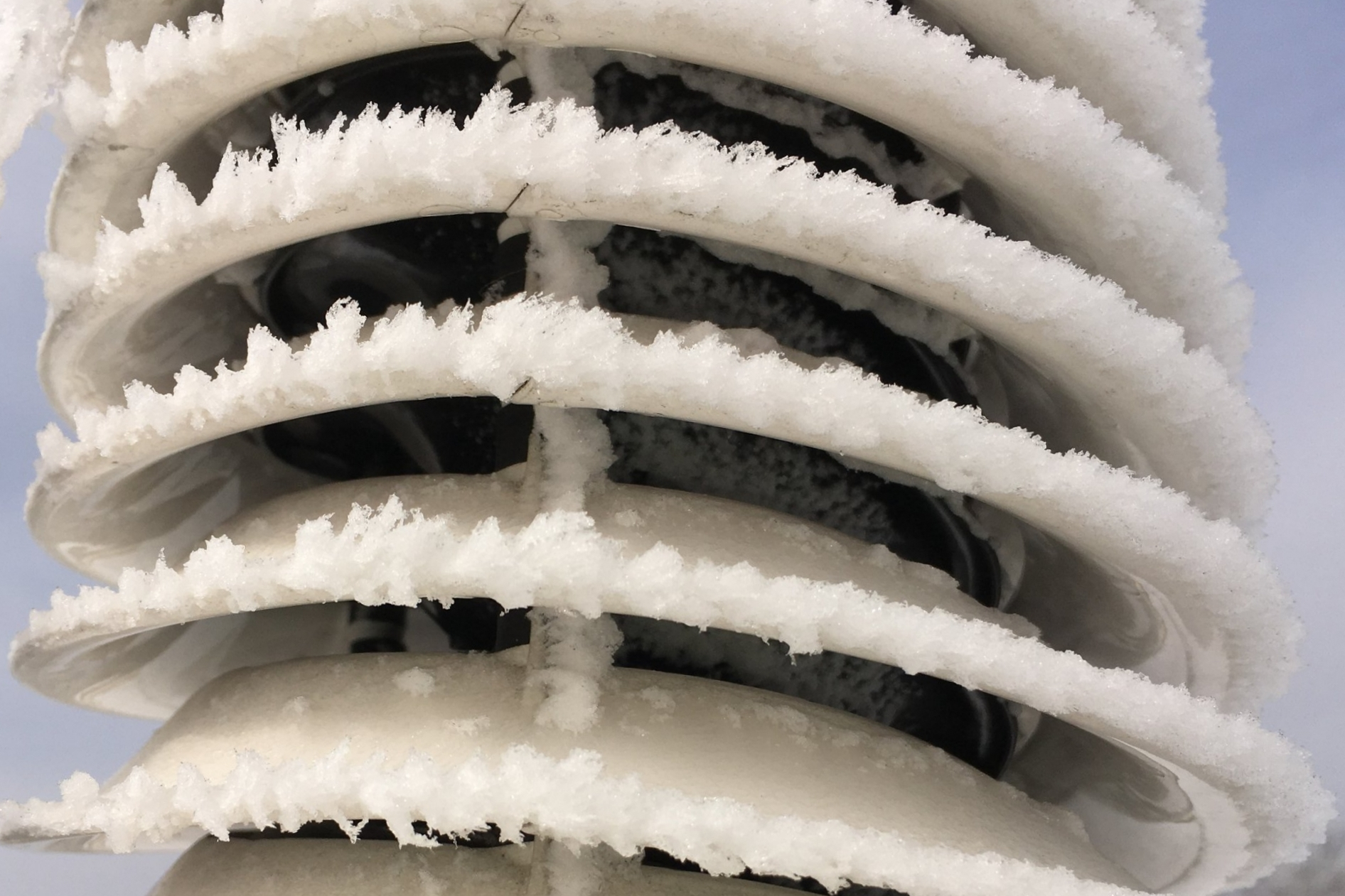 Looking at the inner black louvers OF  METEOSHIELD PROFESSIONAL , one sees ice accumulation on the right side where the airflow is restricted. On the left side the air flows freely so the surfaces are clean. This difference causes spiral vortex flow to form and this SPINNING flow protects the inner sensor from ice accumulation.