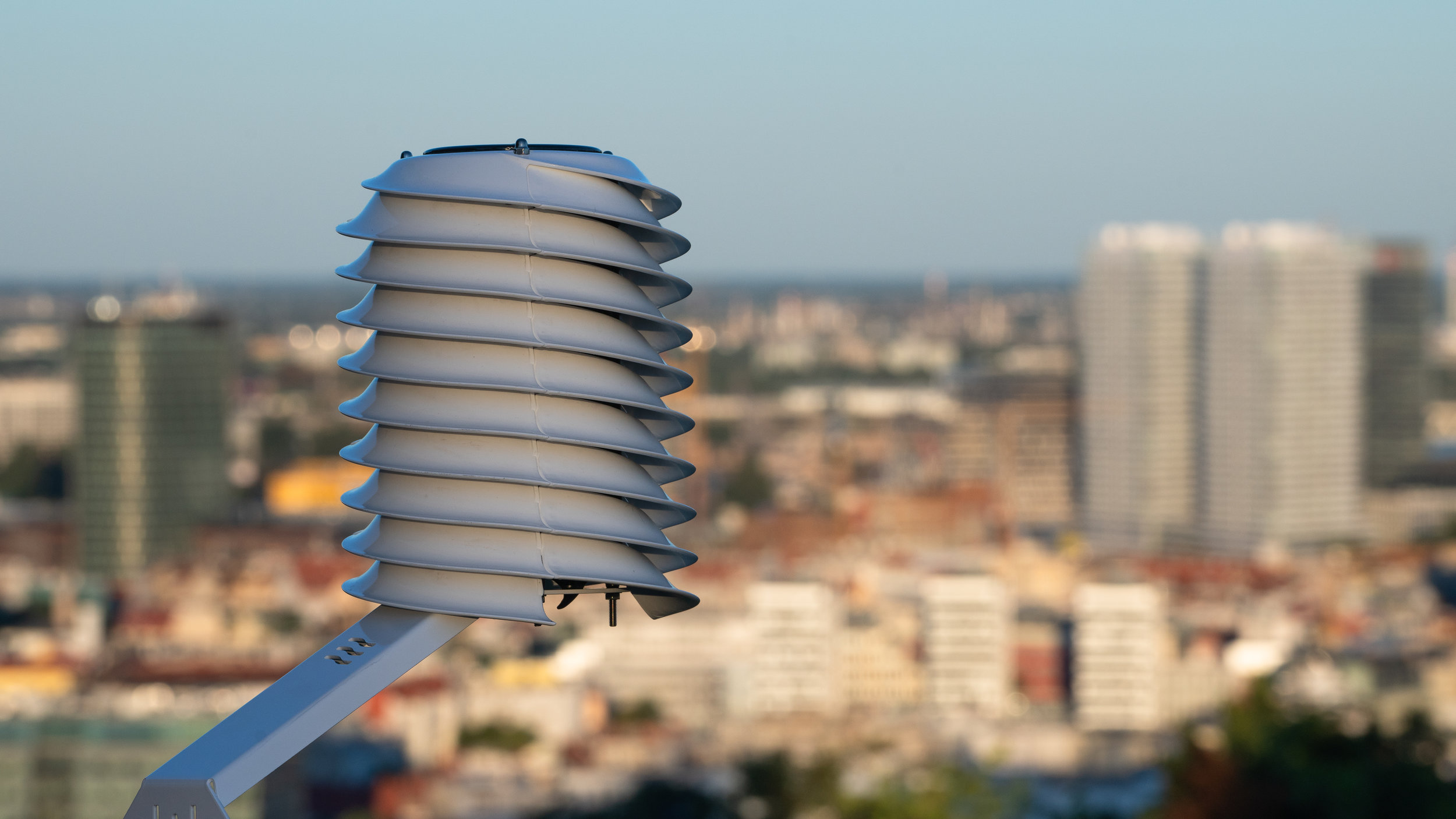 Smart city MeteoHelix IoT Pro weather station overlooking a city skyline