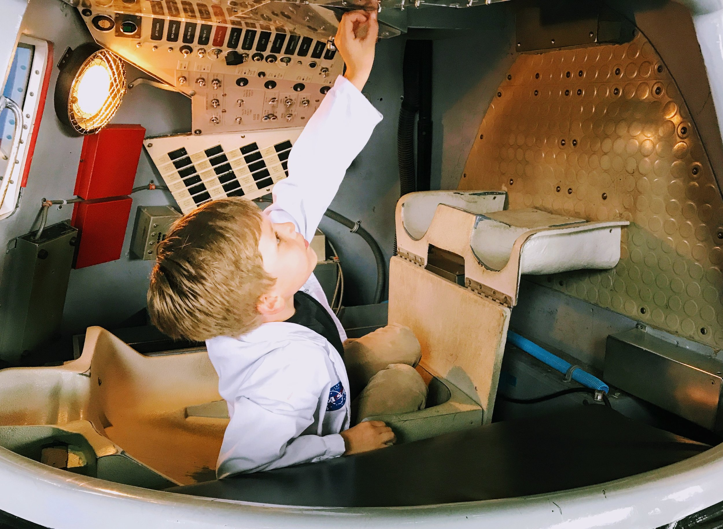 Flipping all switches and pressing all buttons at the U.S. Space and Rocket Center