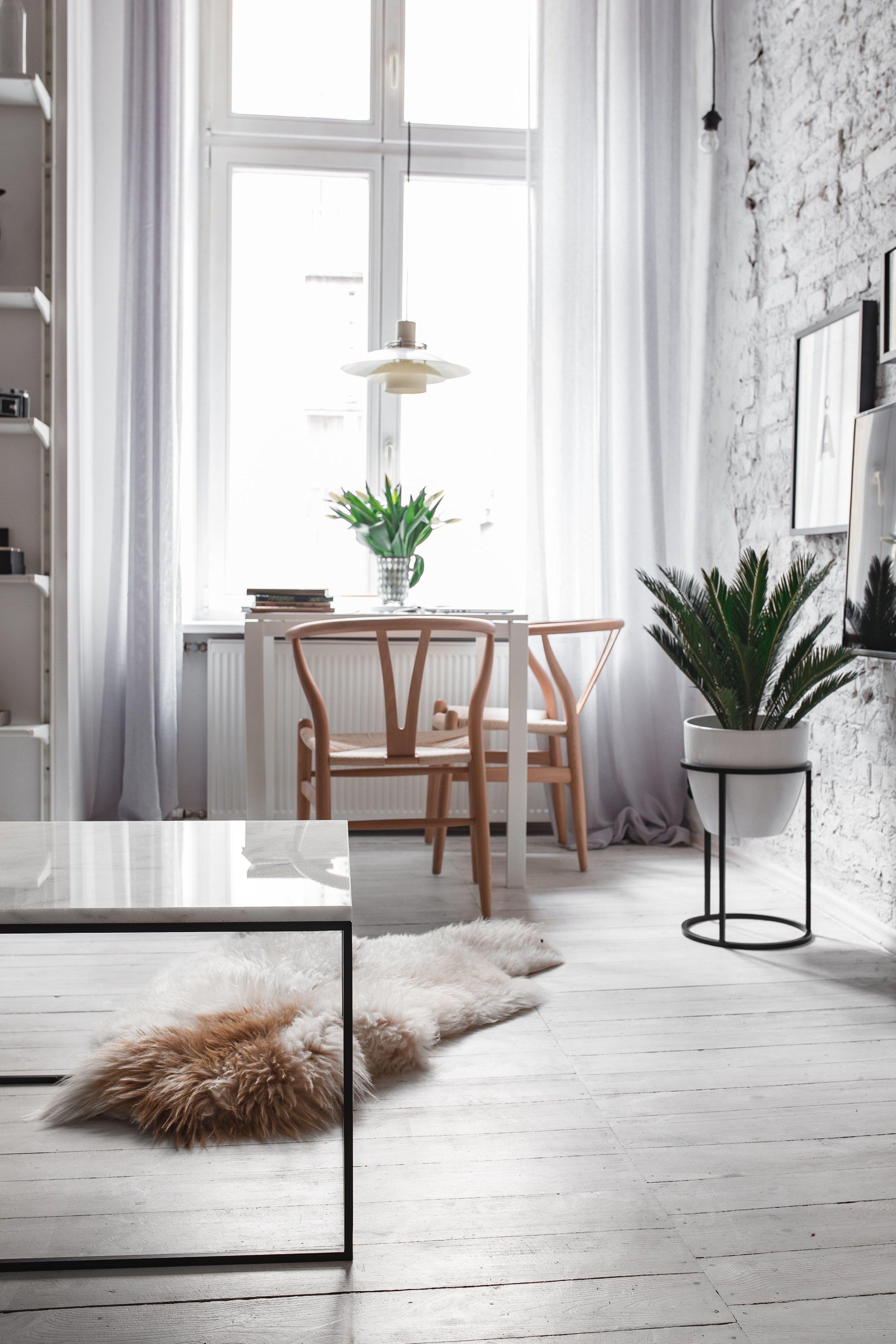 kaboompics_White Living Room With Minimalist Scandinavian Interior Design, Un'common Marble Table.jpg