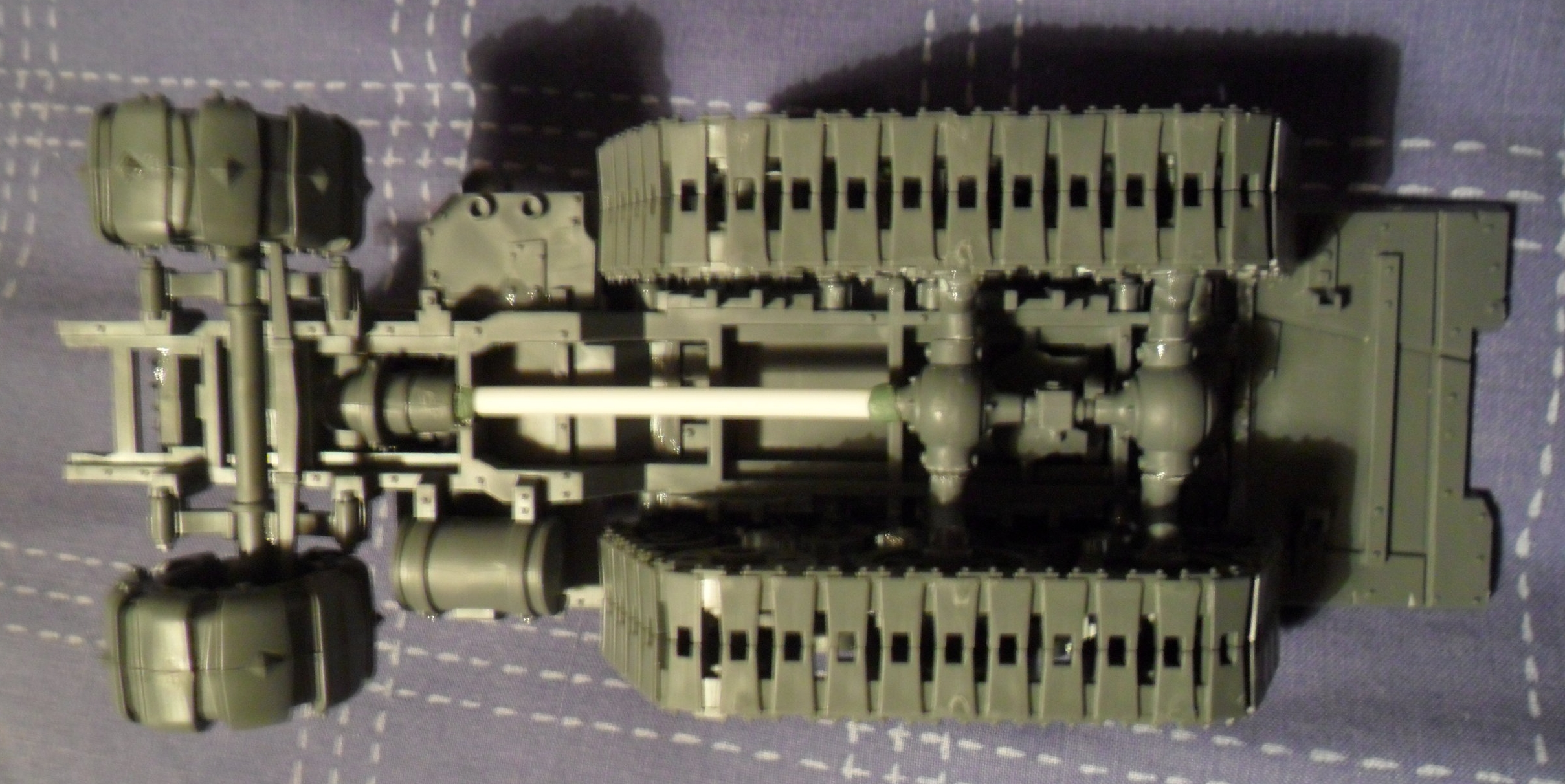 Underneath view showing transmission and axle assembly.