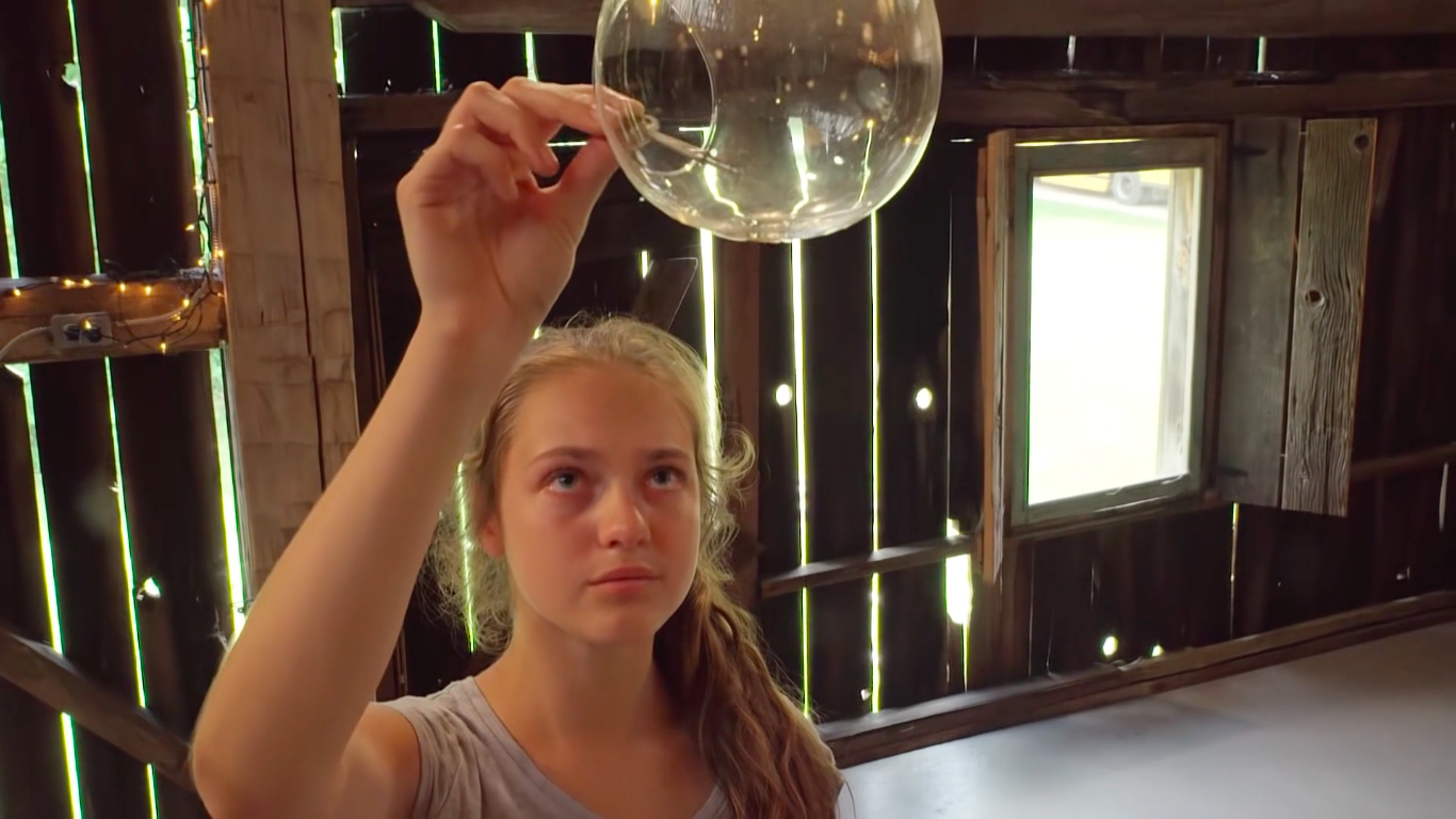 Shot #7 (9:44) - This shot is open to interpretation. Some may see the key as a symbolization of the student's stress, and its placement in the glass globe as a metaphor for emotional release.