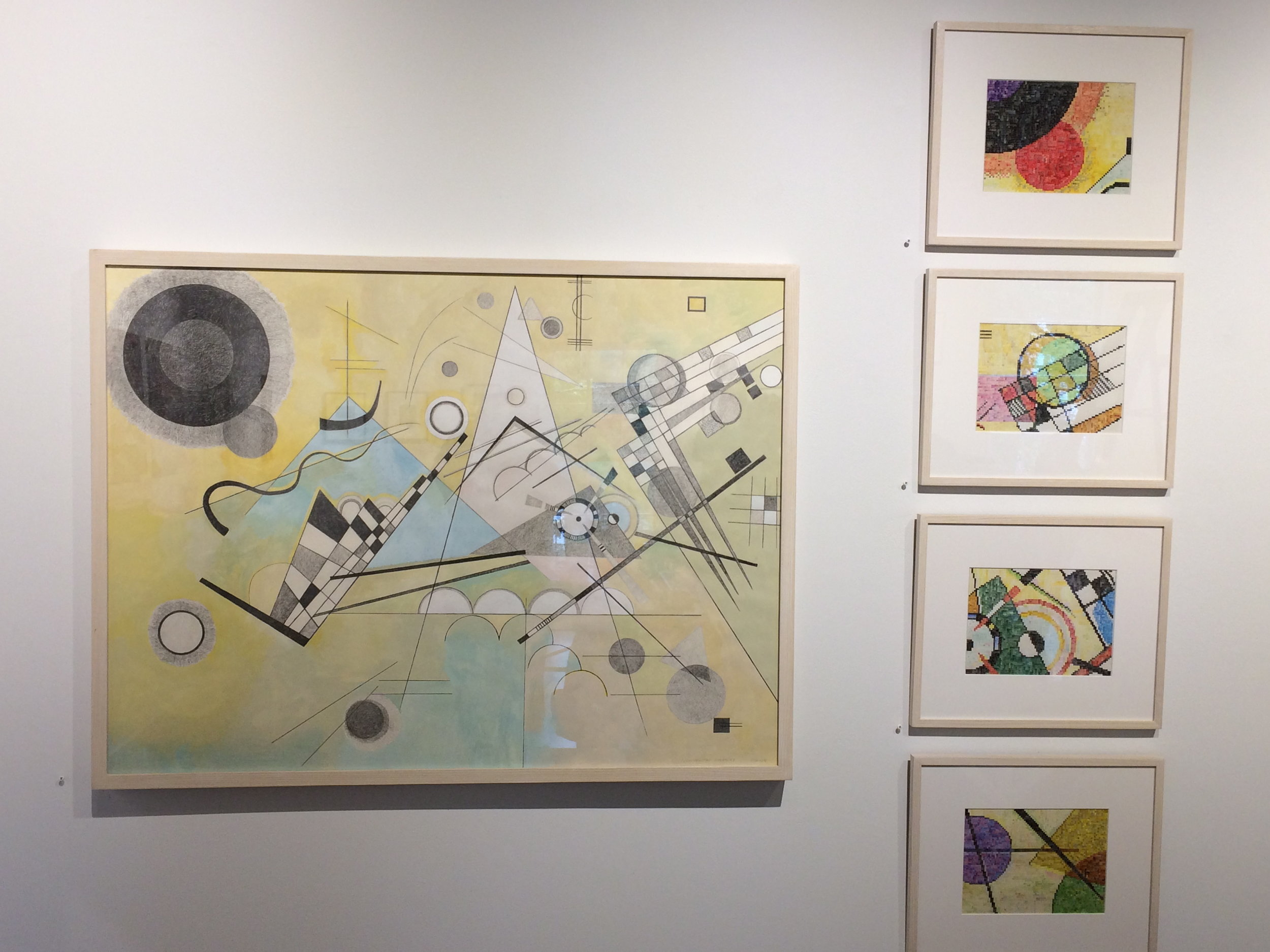 "This series, entitled Deconstructing Kandinsky, is comprised of a rendition of Kandinsky's Composition VIII, but with color only in the background. The ""Blow Ups"" are parts of the painting made larger on gridded paper. The other parts of the series also refer to Kandinsky's painting. Shown here in a gallery."