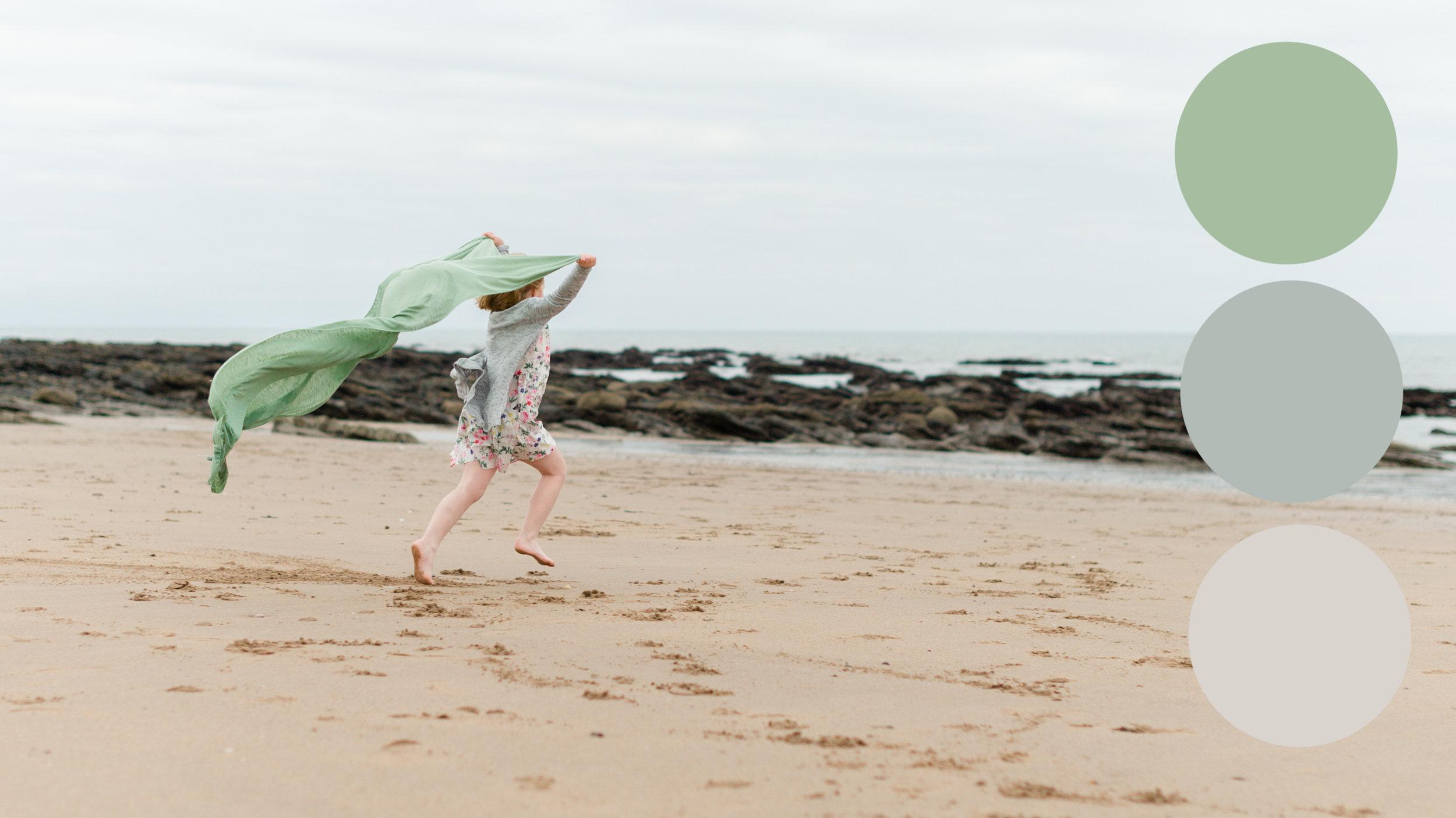 girl running on the beach towards the sea