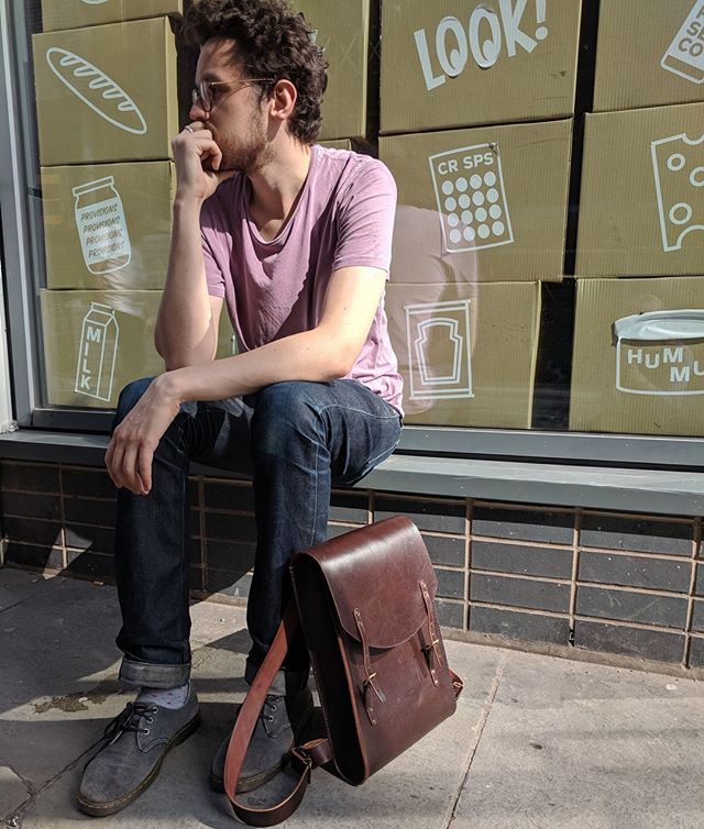 Nice bag? I am not a model. Send help.⠀ ⠀ Thanks for the backdrop @ancoatsgs⠀ ⠀ #ancoats #backpack #leather #leathercraft #shopsmall #handmade