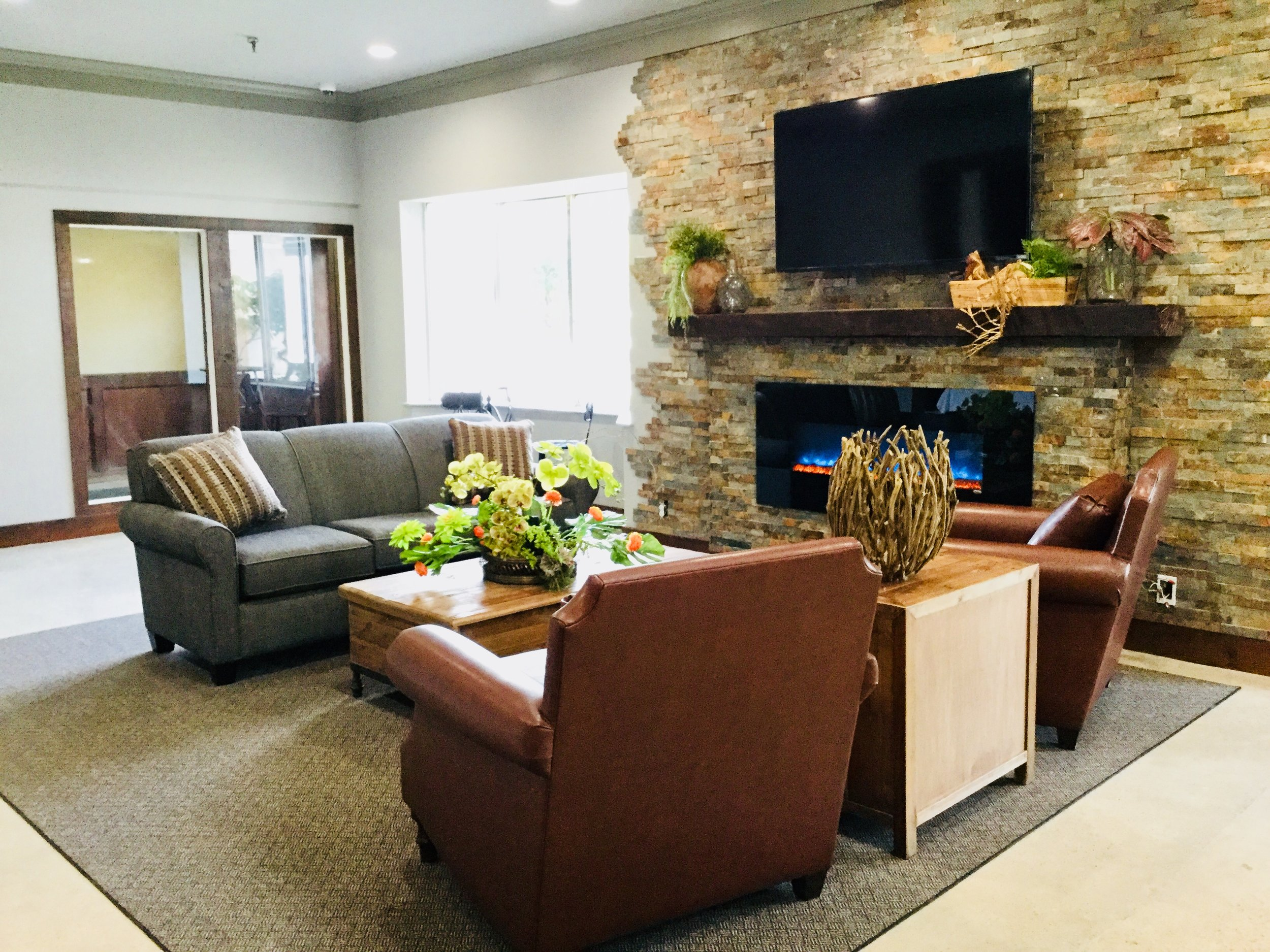 New lobby furniture with fireplace and tv 2018.jpg
