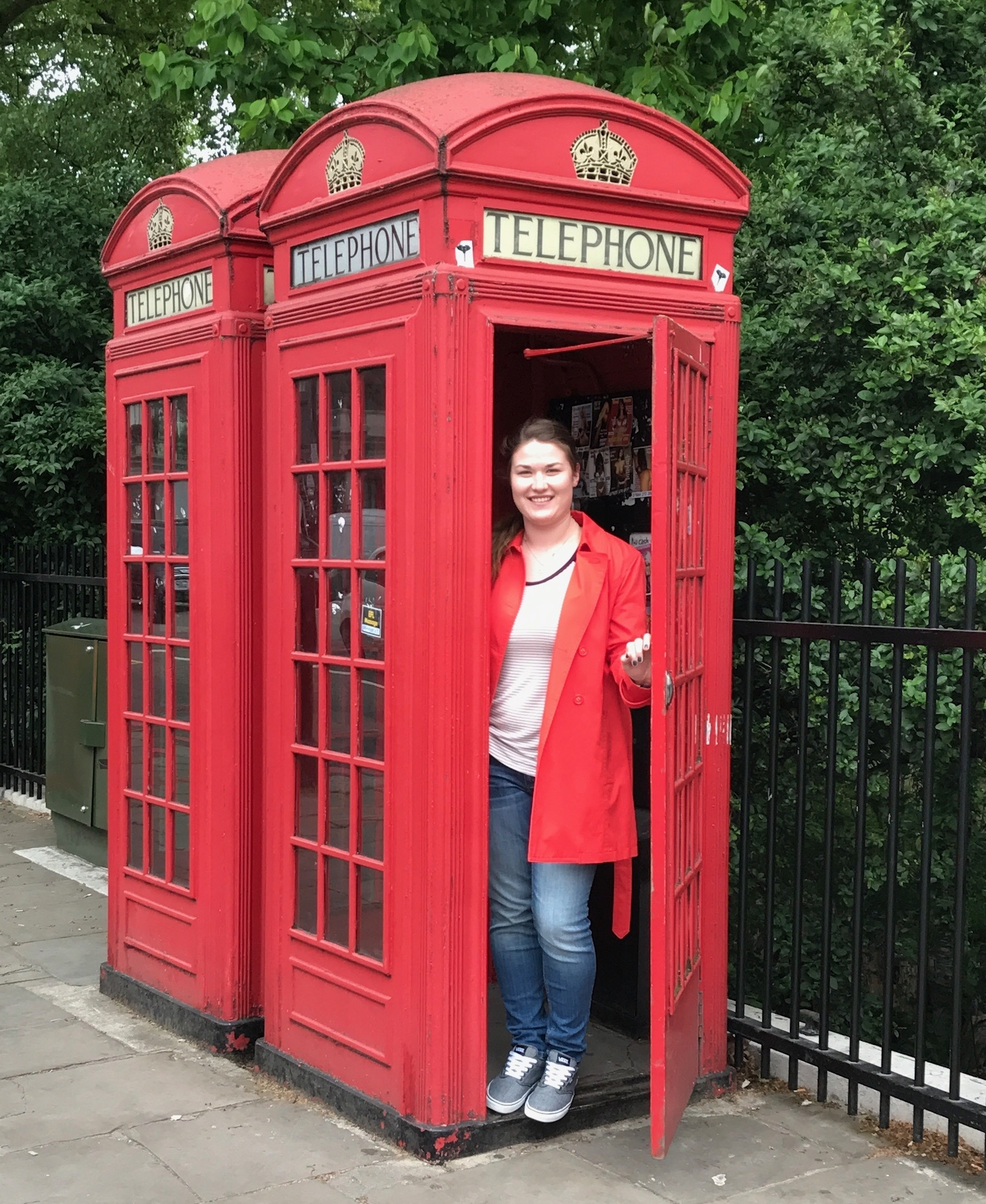 Typical Cliche London Tourist Pic in a Stinky Telephone Booth