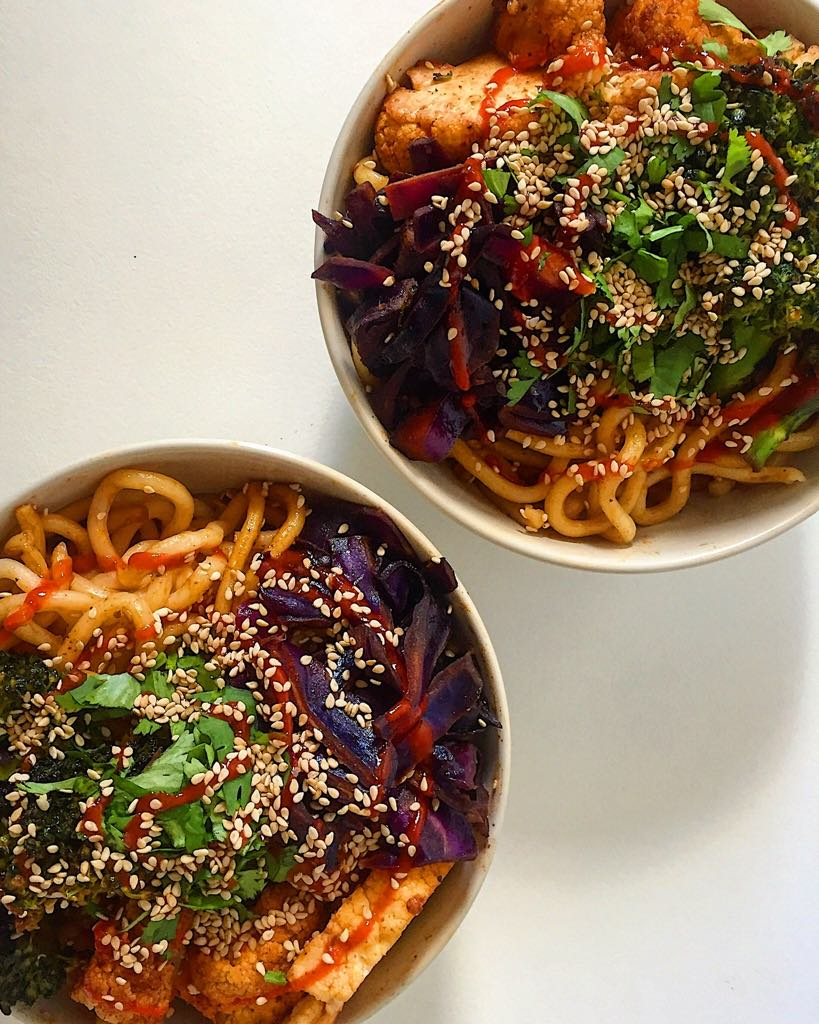 Udon noodles with some simple sauteed veggies and a siracha sesame seed topper.