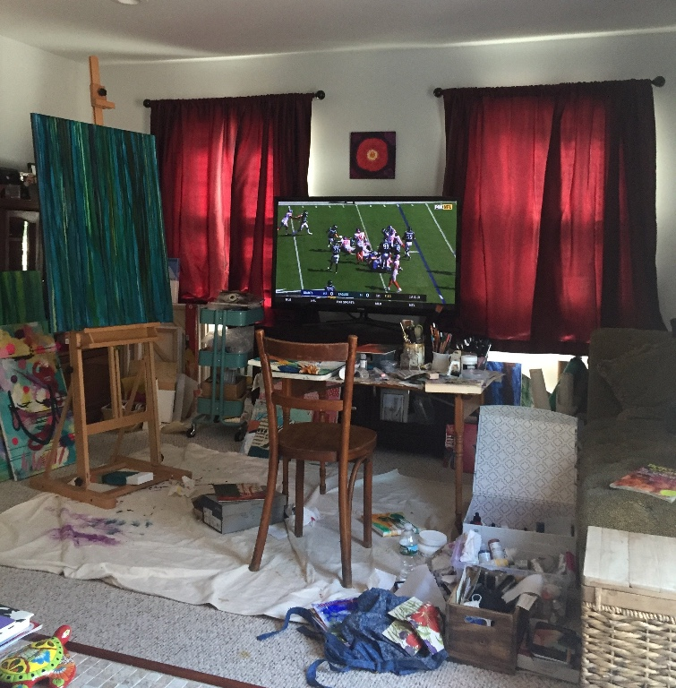 I can't work whenever I want - You can see last week's Eagles-Giants game on the screen in the background. I'm an Eagles fan, but my husband is a much bigger one. And since he tolerates my mess, I don't work when they play, because I'd be blocking his view of the screen, and that would be unfair.