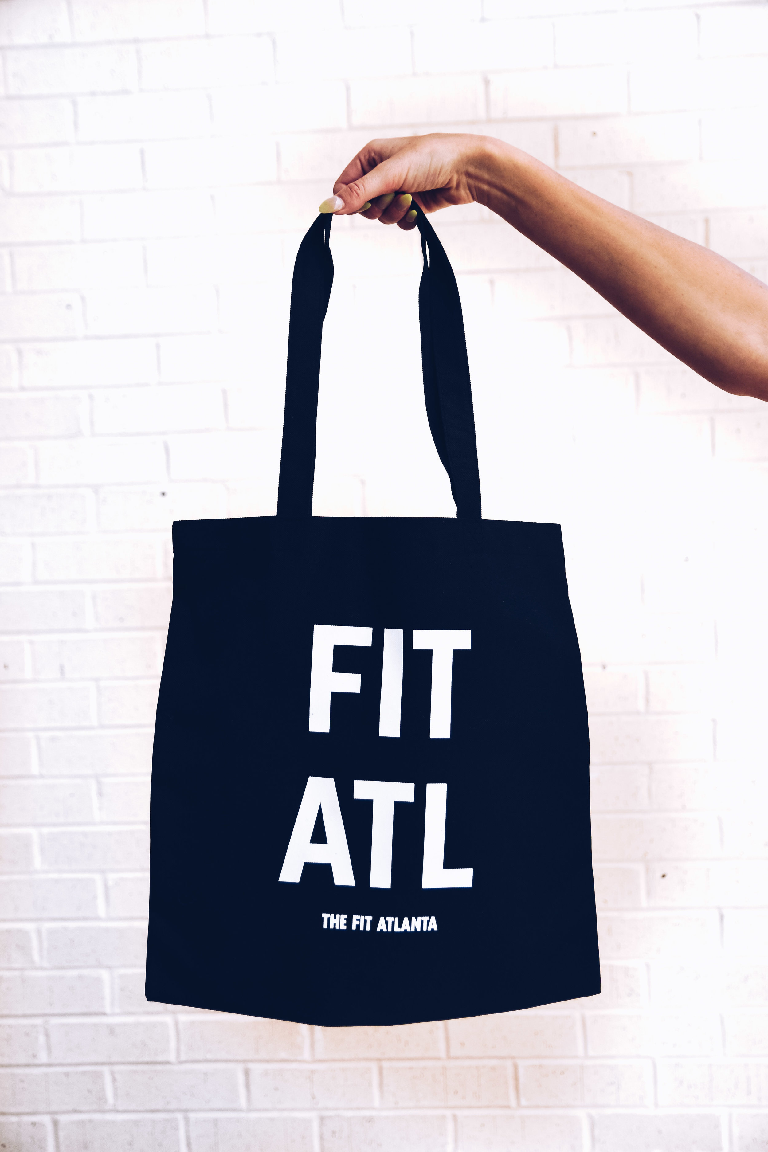 The Fit Atlanta Tote   Our canvas tote bag is exactly what you need to take to the gym, use as a reusable shopping bag, or take to the pool. Preorder yours now!
