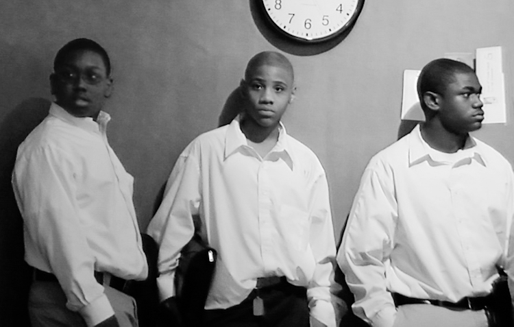 """Tyree (center) inside E Prep, the Cleveland charter school featured in Laura Paglin's documentary """"Facing Forward."""""""