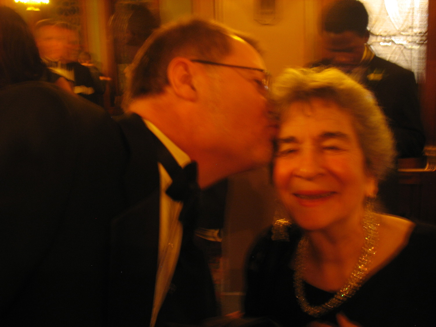 Festival Director Jeff Sparks plants a kiss on mom