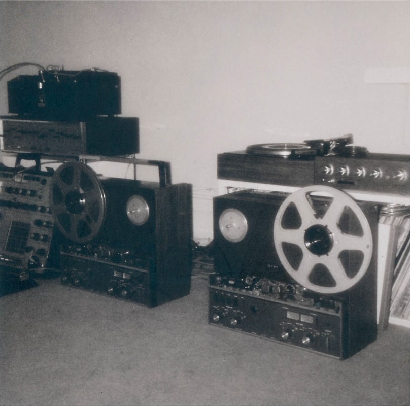 Brian Eno's Discreet Music setup. Two tape machines, the Synthi on the far left, and the graphic EQ and Echoplex above.