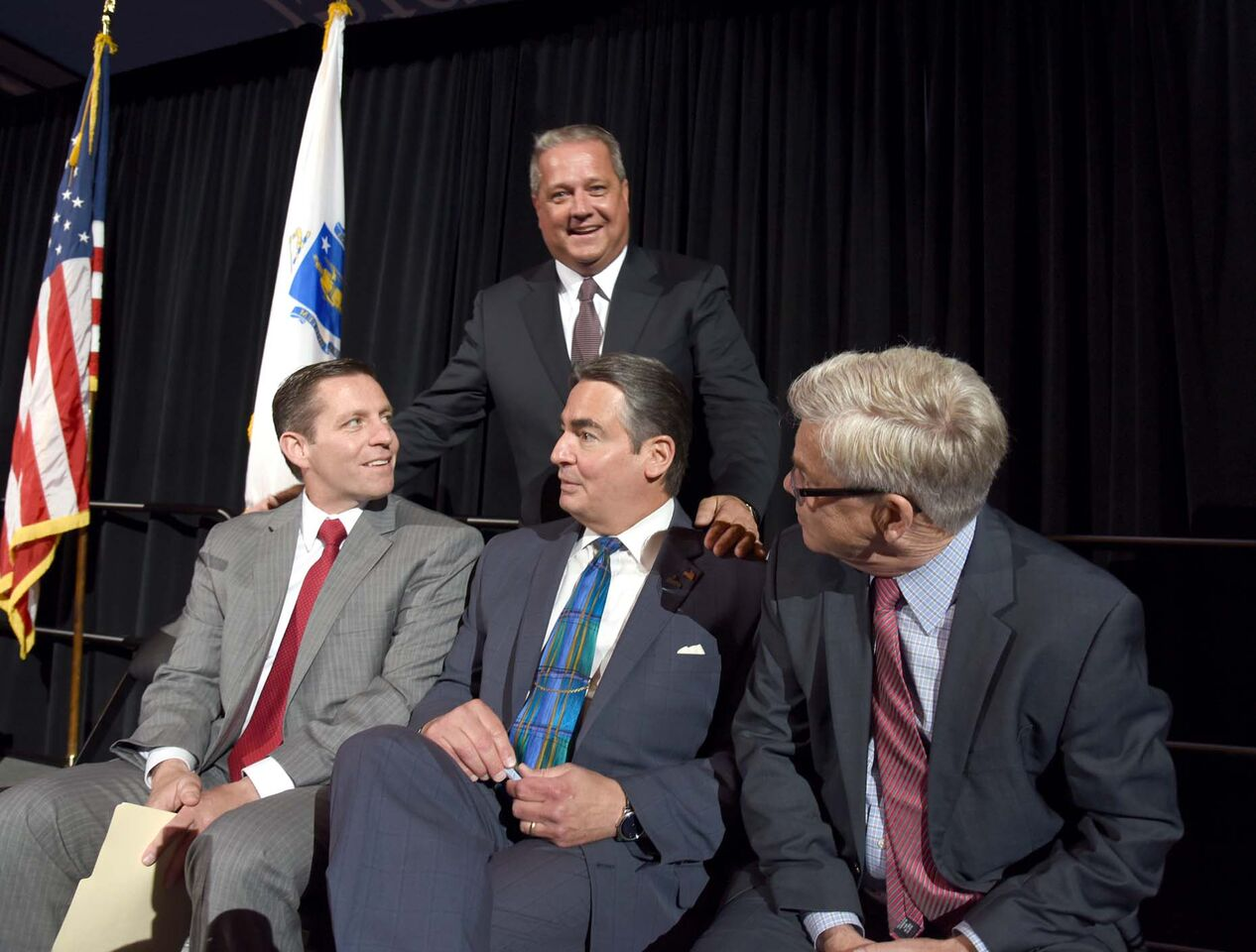 Dennis Murphy with (from left to right) Fred Peterson, Deputy Director of the Massachusetts Convention Center Authority, Springfield Mayor Domenic Sarno and David Andrews, President and CEO of the American Hockey League, at the unveiling of the Springfield Thunderbirds, the AHL affiliate of the Florida Panthers, at the MassMutual Center on June 15, 2016.