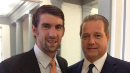 Dennis Murphy with Michael Phelps.