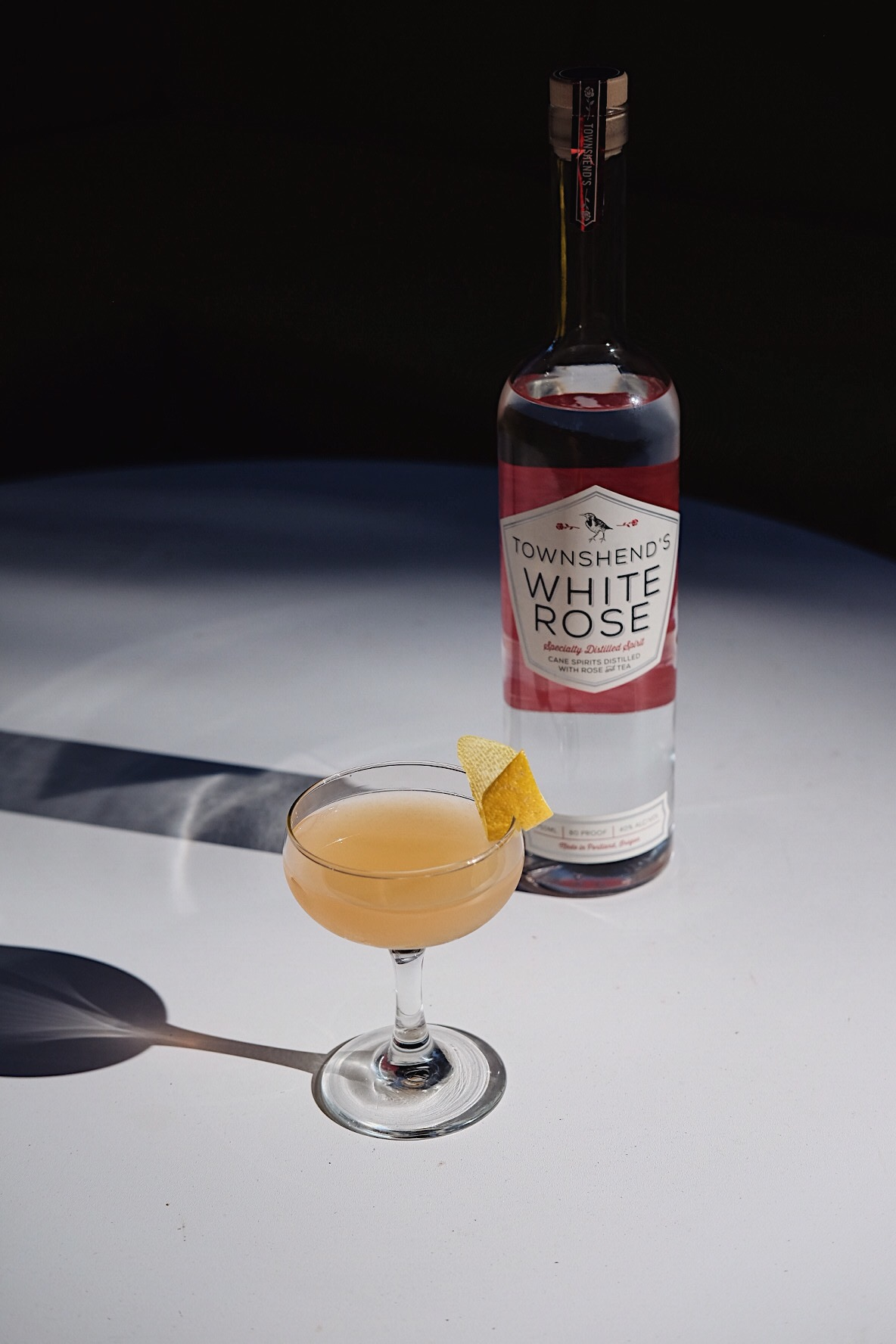 ingredients: - 1 1/2 oz White Rose Spirit1/2 oz Cascadia Bitter Liqueur3/4 oz pink grapefruit juice1/4 oz honey syrupGarnish: lemon zest