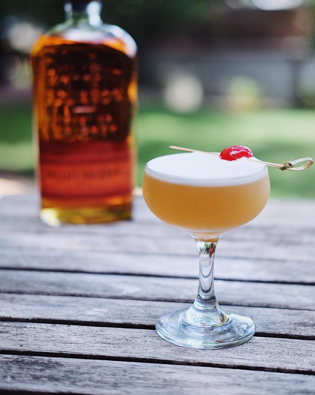 ingredients: - 2 oz bourbon or rye3/4 oz fresh lemon juice3/4 oz simple syrupEgg whiteGarnish: cherry