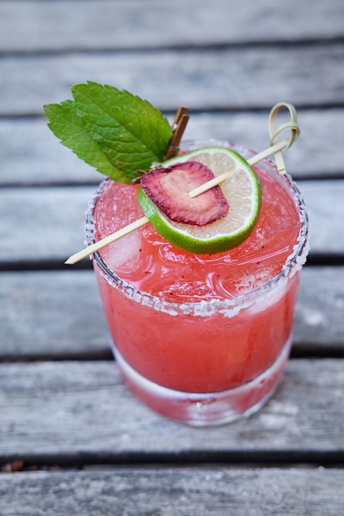 ingredients: - 2 oz reposado tequila1 1/2 oz strawberry puree1/2 oz fresh lime juice3/4 oz rhubarb simple syrupGarnish: Fresh mint, lime wheel & dehydrated strawberry