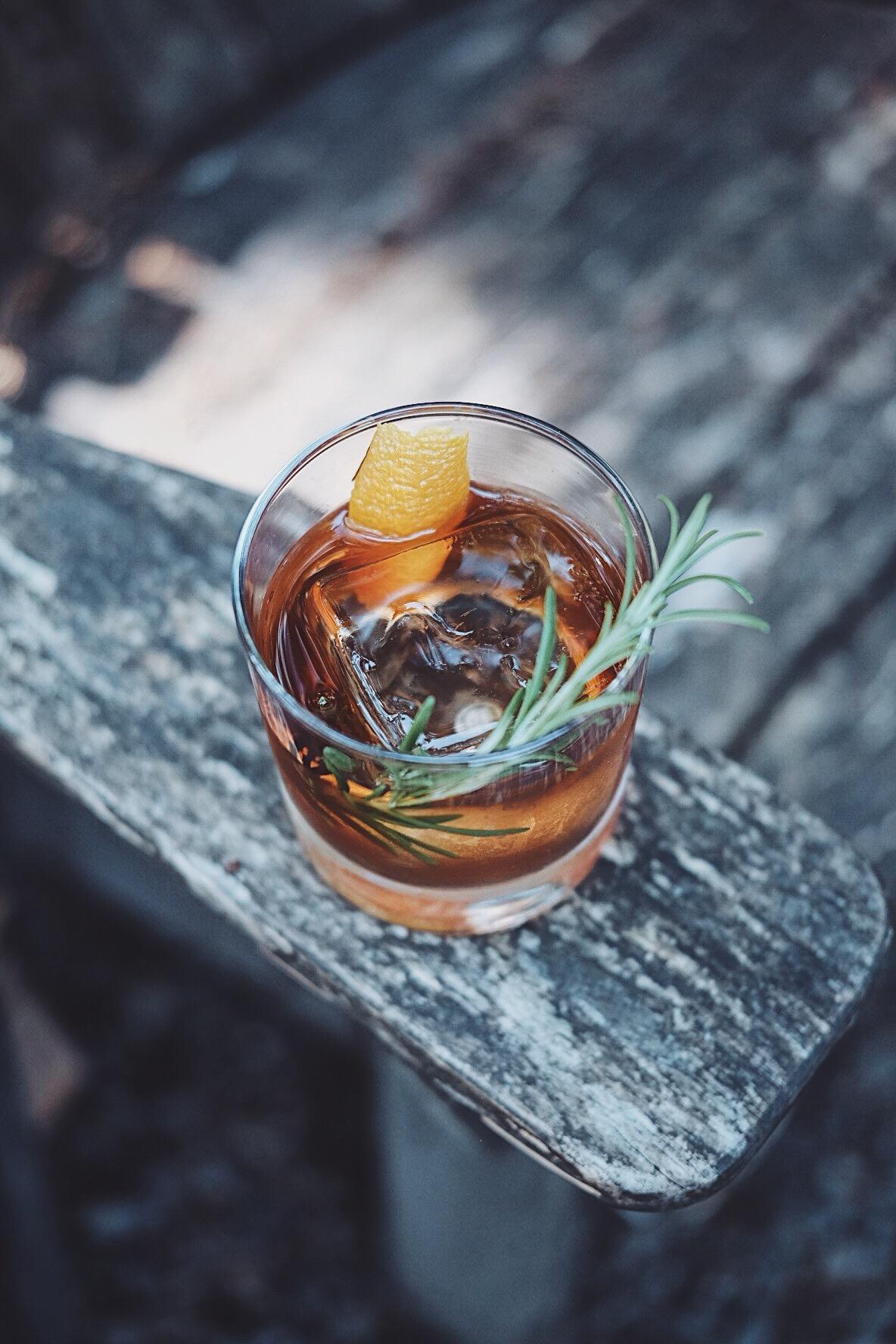 ingredients: - 1 1/2 oz aged rum1/2 oz Alpine liqueur1 tsp Demerara syrup1 dash aromatic bitters2 dash chocolate bittersGarnish: Orange peel & rosemary