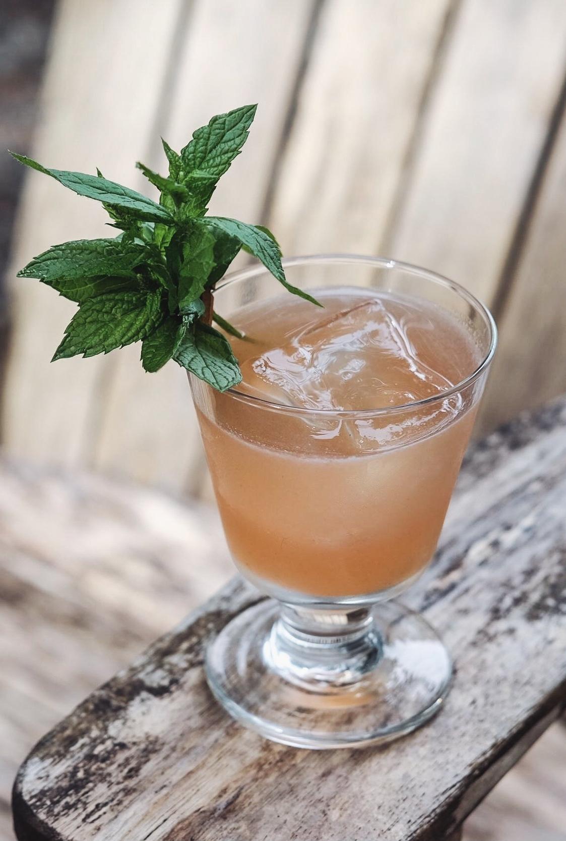 Half the Garden - 1½ oz Pear-infused vodka¾ oz fresh lemon juice3 mint leaves3-4 blueberries¼ oz honey simple syrup