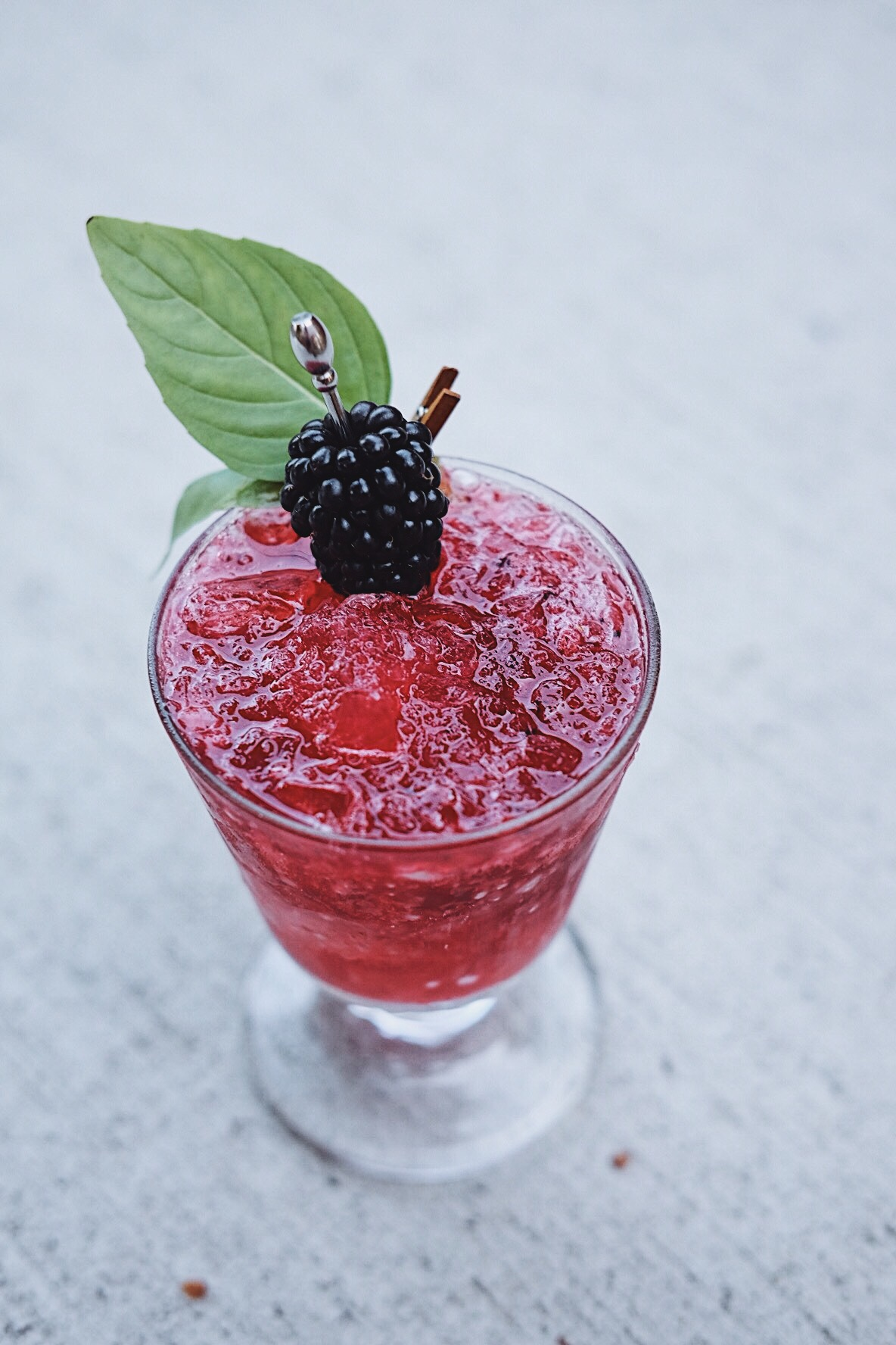 ingredients: - 1 1/2 oz bourbon1/2 oz ginger liqueur1/2 oz fresh lemon juice1/4 oz honey syrup2-3 blackberriesBasil leaves